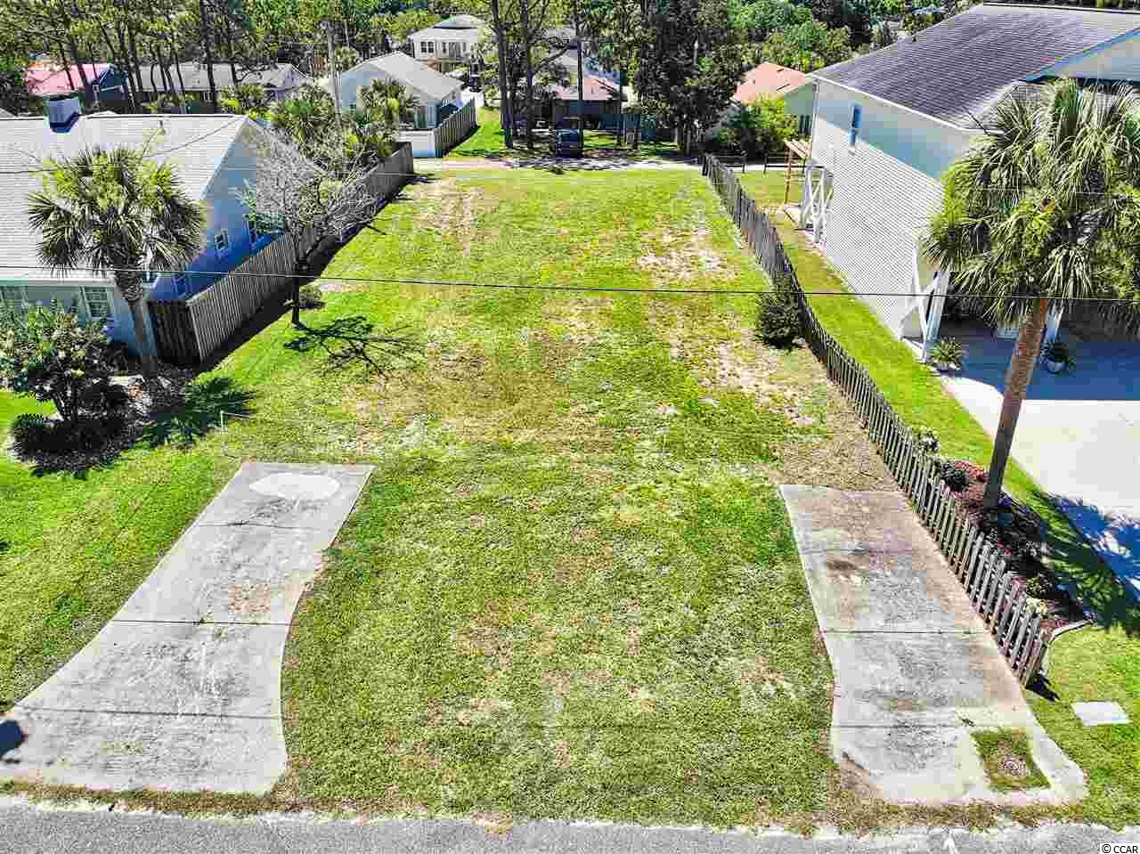 LOCATION! LOCATION! LOCATION! Great place to build your new house at the beach!!! One of the most desirable neighborhoods, just a couple of blocks away from the ocean. Only minutes away from all the attractions that North Myrtle Beach has to offer! Has a water line that has been tapped and access from both side of the lot for your convenience. Rare find, ready to build!!!No HOA.