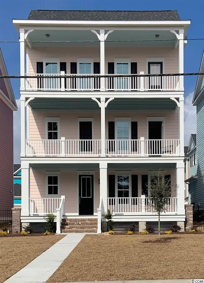 Feel the ocean breeze from 3 large porches. This 5 bedroom home features a rec room, gourmet kitchen with quartz countertops, maple cabinets, gas cooktop and large center island. Master bedroom has a private porch, walk-in closet, and master bath with walk-in shower and free standing tub. This 3 level home is equipped with an elevator and laundry on the 1st & 3rd floors. Just a short stroll or golf cart ride to the beach, shopping and dining.