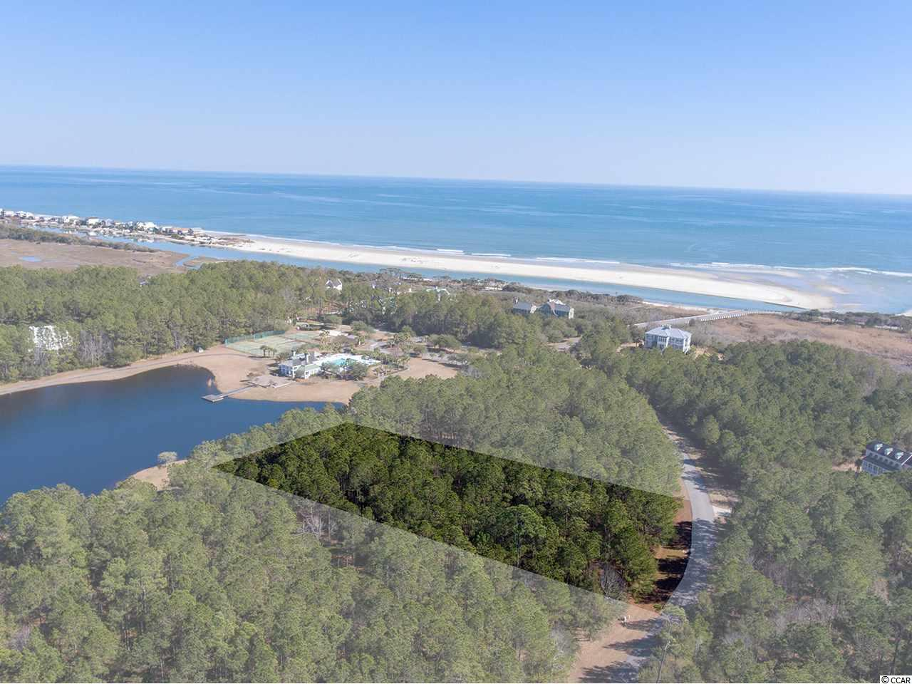 Come enjoy the stunning beauty of the oceanfront, gated community of Prince George in Pawleys Island, SC.  Prince George has long been known as one of the most pristine and private areas on the East Coast.  Lot 107 overlooks the lake and Ocean Clubhouse and is already cleared, ready for building!  You're just a short walk away from the Prince George amenities including tennis, a pool, playground and volleyball and this lot is high and dry!  You can drive onto the lot to check out the views...come see today.