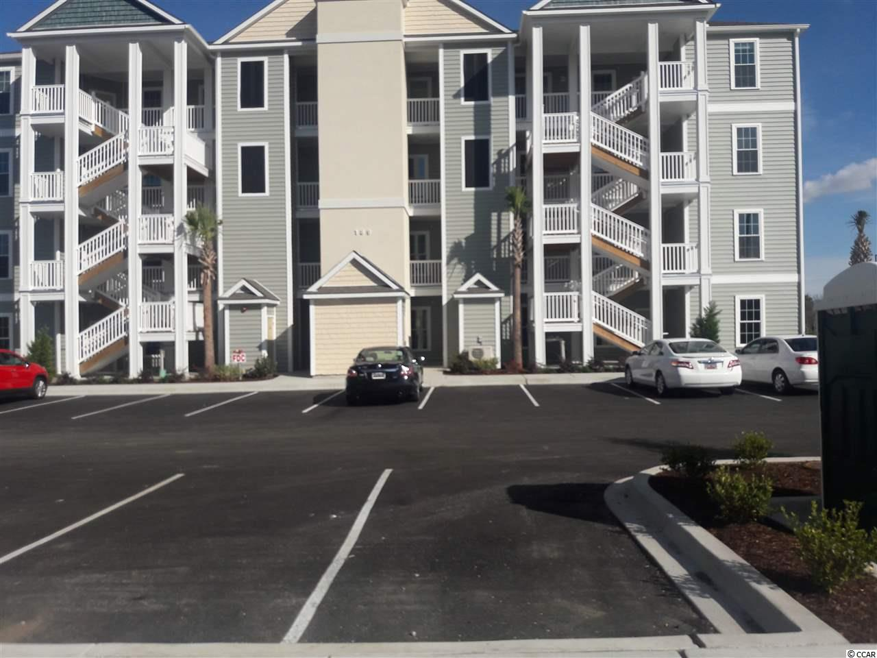 Located in one of the most successful condo developments in the Myrtle Beach area, this fourth floor end unit is a 3 bedroom 2 bathroom beautiful condo in the very popular Queens Harbour! Building has an over-sized ELEVATOR to all floors, outside storage, split bedroom floor plans with entry to the Master Suite from the Family Room, 9' smooth ceilings and a screen porch. The location is superb with shopping, dining and recreation steps away. The amenity package includes a resort style swimming pool with club house and conveniently located picnic areas with barbecues.