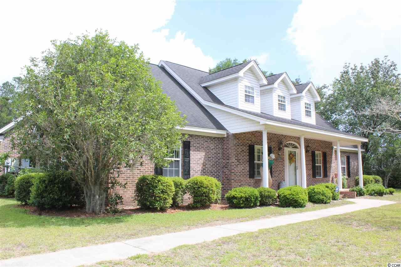 Beautiful all brick home with a water view on a DOUBLE LOT (corner lot). Plenty of indoor and outdoor parking (3 car garage and large outdoor concrete parking area for boats and RVs). Some of the other features include- Hardwood floors in the kitchen, wood-burning fireplace, Corian countertops, and stainless steel appliances, slide-out pot/pans cabinet in the kitchen, crown molding, new epoxy flooring in one bedroom, large laundry room, new AC 2019,  huge 2nd-floor bonus room with two bedrooms and a full bathroom, sink and built-in fishing pole/supply closets in the garage. You will enjoy this quiet, peaceful home located on a dead-end street. Close to everything Georgetown has to offer, only a few miles to the local boat ramp and only about 20 minutes to Pawleys Island Beach. CLICK THE VIRTUAL TOUR LINK FOR A VIRTUAL SHOWING INCLUDING: FLOOR PLANS, HD VIDEO, 3D TOUR, PICTURE GALLERY, INTERACTIVE MAP, AREA ATTRACTIONS AND MORE. All measurements and square footage are approximate. Buyer is responsible to verify.