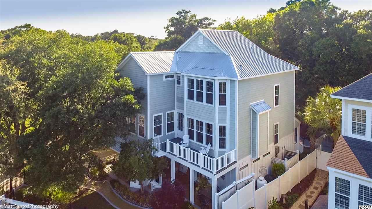 """This home is a must see and is located in the heart of Murrels Inlet. In addition to the water front  location,  this property has it """"all"""".....bulkhead,floating dock, boat-lift ,summer kitchen, elevator, and oversized garage. All of this and more luxury interior appointments !!! The intereior boasts """"heart pine"""" flooring with tile in wet areas and other  real nicely  trimmed out appointments  for comfort, leisure and of course the spectacular view of Carson Creek . By all means this home is a must see !!  Thank you ...... easy to be seen also ."""