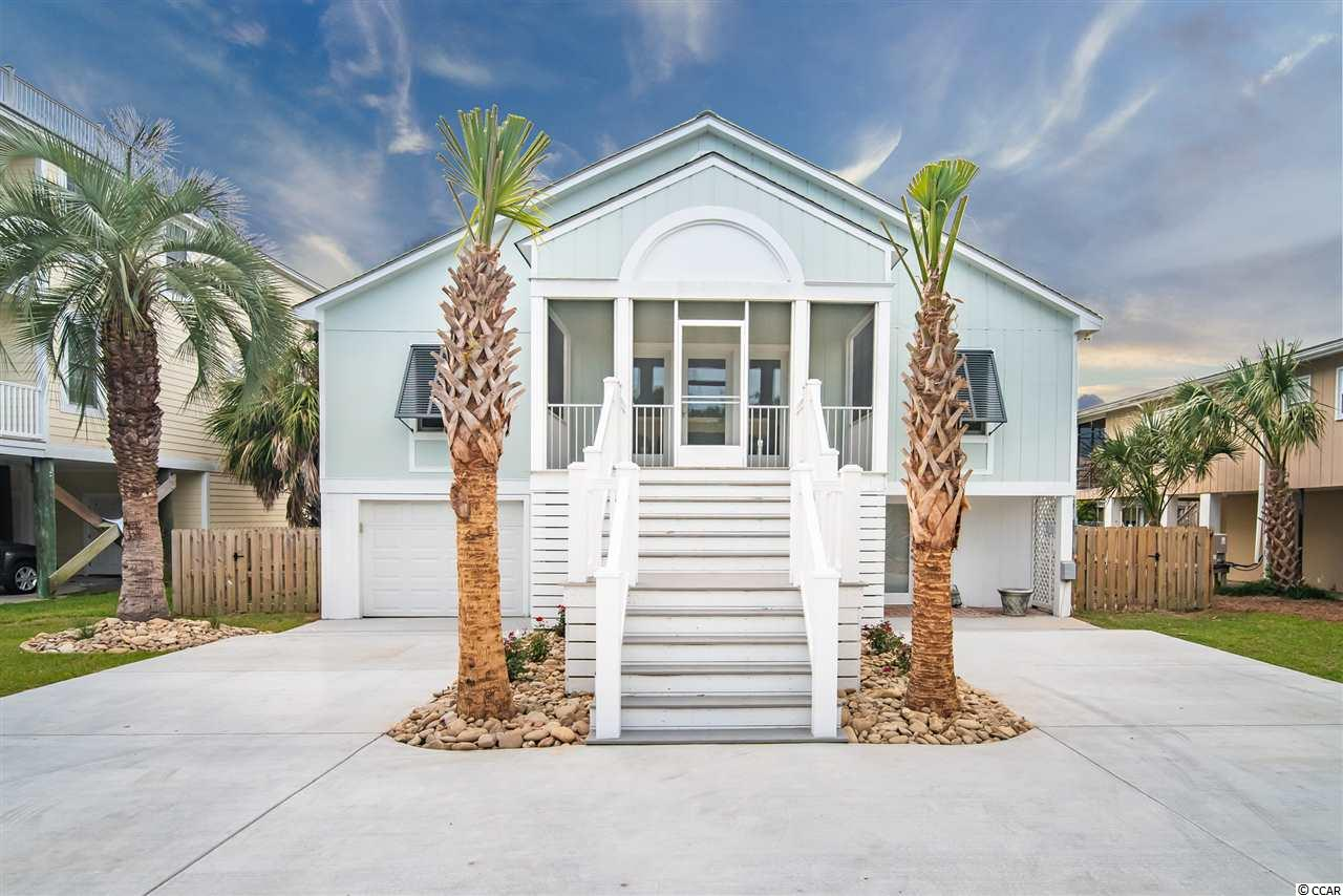 Great newly updated home on the canal in desirable South Litchfield Beach.  This spacious home with two living areas has plenty of room for family and friends.  Fantastic views of the creek in Litchfield with your own private dock.  The upstairs master bedroom features a private washer and dryer, large walk in closet and two full sized his and her bathrooms!  The main living floor has 3 gracious sized bedrooms, two baths, family room, living room and large kitchen.  The family room opens up to a huge deck to enjoy an afternoon cold drink after spending the day fishing or hanging out at the beach.  Leave right from your dock and catch flounder in the creeks or explore down to Midway Inlet.  Downstairs has a second laundry room as well as a full mother-in-law suite with den, kitchenette, bedroom, bathroom and screened in porch!  New furnishings throughout the entire home and large backyard.  Floor plan in photos.   Unbelievable location close to fine dining, boutique shopping and a quick walk to the beach!  Litchfield is located just a 70 mile drive for a day trip to historic Charleston, SC or 25 miles to the attractions of Myrtle Beach!  You can have it all.
