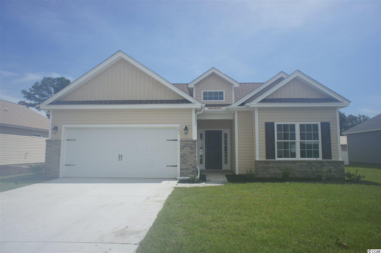 Beautiful Hatteras floor plan in the new Ocean Palms community. This terrific open floor plan, 3 bedroom, 2 full bath home has a live dormer with a high ceiling and vault over the great room and wood-look vinyl flooring throughout. Stainless appliances, granite counters, staggered-height white painted Shaker-style cabinetry and a convenient breakfast bar combine to give you the wow factor you're looking for, and abundant recessed lighting plus two large windows in the adjacent dining area flood the room with light. There's even a large walk-in pantry. A French door in the great room leads to the covered rear porch and the large separate patio beyond. The spacious master retreat features a long vanity, an oversized walk-in shower, plenty of storage in the linen closet and a huge walk-in closet, plus a tray ceiling. Two additional bedrooms and a full bath are tucked off on their own hallway, for privacy.  All of the homes in Ocean Palms come standard with the luxury of natural gas (tankless water heater, gas heat, and gas range). The two car garage is completely trimmed and painted, and a floored attic storage space is accessed by drop-down stairs. Ocean Palms is conveniently located near shopping, restaurants, schools and world class medical offices and hospitals, and only a short golf cart ride to Surfside Beach's gorgeous beach and the beautiful Atlantic Ocean. Other floor plans and inventory homes may be available, and CUSTOMIZATION OF FLOOR PLANS IS POSSIBLE!!! Community Pool and Cabana Coming Soon! Photos are of a completed, similar home and may have different features.