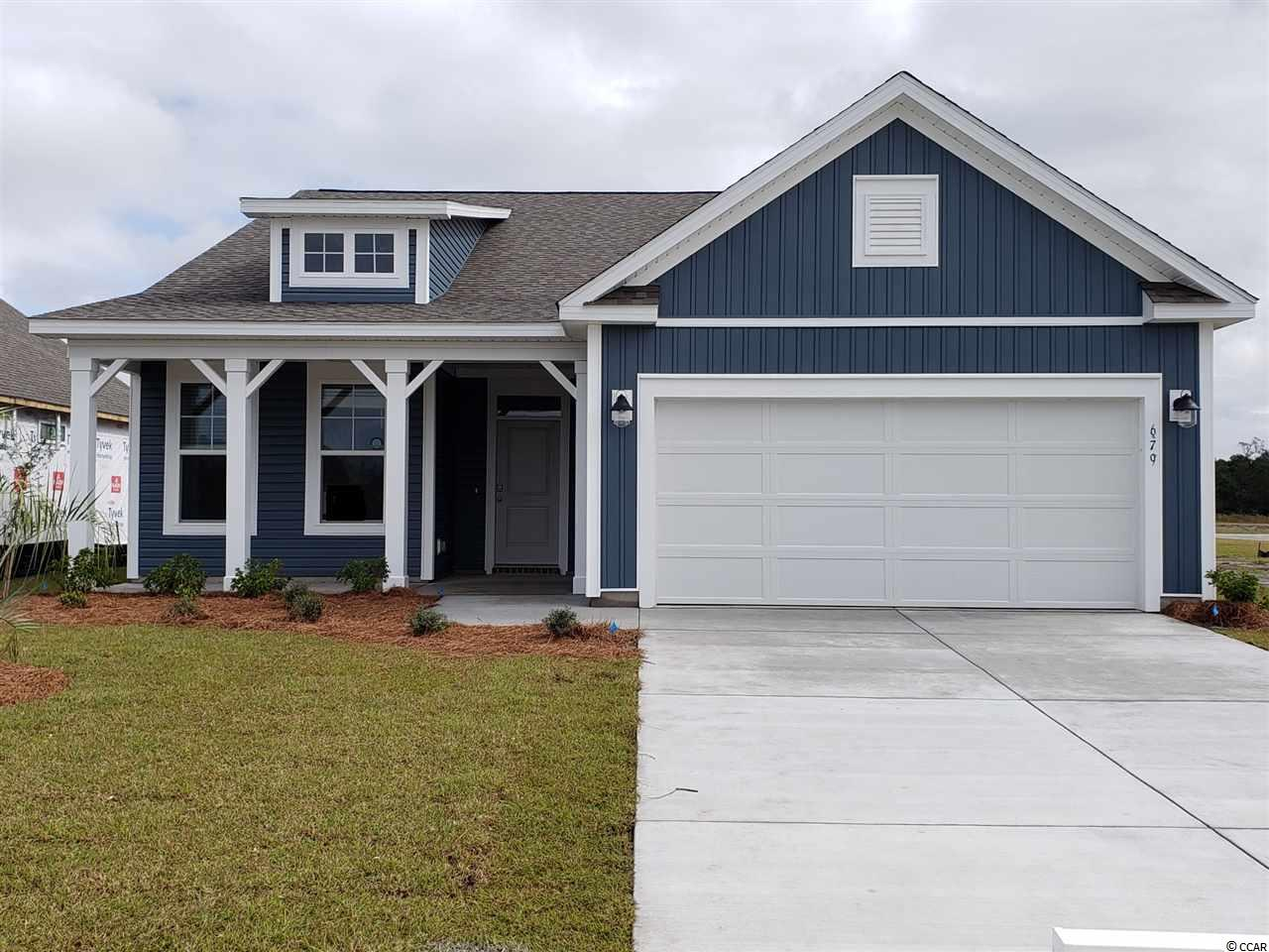 Pictures shown are from a previously built home. Laurel floorplan featuring one-story living with 4 bedrooms, 2.5 bathrooms, and 2-car garage space.