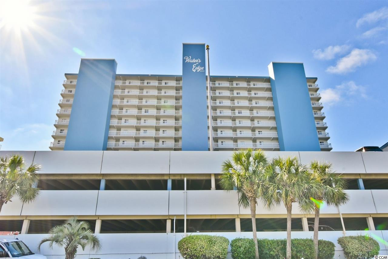 Here is your chance to own a well kept second floor ocean front condo in one of Garden City Beach's most popular buildings.  This unit features ceramic tile floors in the living area, a large work island, and many other upgrades in the kitchen.  The views from the balcony are first rate.  The one bedroom units at Waters Edge include 1.5 bathrooms.  Located right in the heart of Garden City, Waters Edge offers great access to some of the area's best beaches and attractions.  Amenities include indoor/outdoorswimming pools, oceanfront hot tub/sundeck, poolside BBQ, parking garage, snack bar/shops and 24-hour security. Owner's are allowed pets.