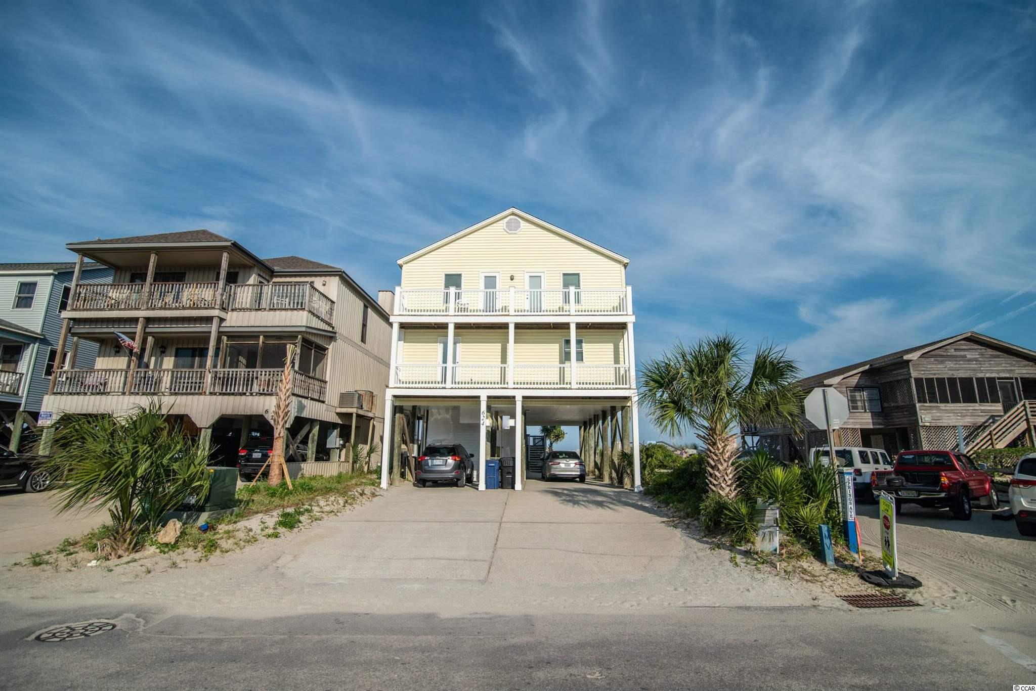 """This Pawleys Island oceanfront home enjoys a recently re-nourished beach, beautiful sunrises, and a great vacation home floor plan. Whether your needs are full time, part-time, or as an income producing beach rental """"4Hands"""" will be a great choice. First floor includes great room and huge dining area overlooking the Atlantic, the kitchen offers plenty of counter and storage space, and a full bath and a bedroom with balcony. Upstairs you will find four additional guest rooms, two baths, and a laundry room. Plenty of closets throughout and large enclosed storage underneath as well as parking. Great  decks front and rear on each floor to absorb the sun and ocean breezes. Pier and deck over the dunes for seating and private access. Short drive to Pawleys creek, dining, shopping, numerous golf courses, and intra-coastal waterway access."""