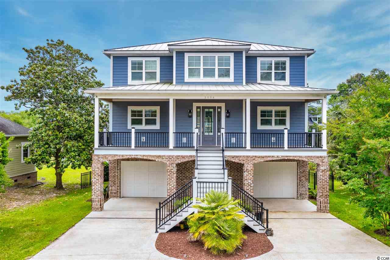 MAJOR PRICE REDUCTION! A true LOW COUNTRY MASTERPIECE in the CHERRY GROVE section of North Myrtle Beach with NO HOA! This 4 Bedroom, 3.5 Bath PERSONAL BUILDER residence was designed and constructed in 2018 on a quiet residential street east of Highway 17 in North Myrtle Beach. The home is located on a small pond teeming with nature with a fenced backyard and custom swimming pool. From the wall framing to the interior finishes, nothing was overlooked with the construction of this residence. Exterior features include: Hardie Board siding, Metal roofing, Large covered front & rear porches with Trex decking and aluminum railings, Brick accents, Fenced backyard, Swimming Pool, Paver pool deck, Large covered rear porch, and lush landscaping. Interior features include: true custom kitchen cabinetry with soft close hardware and granite counter tops, stainless steel kitchen appliances & range hood, Natural Gas Range, Double Oven, expansive kitchen island, Natural Gas Fireplace in Great Room with Built-In cabinetry, crown molding throughout, Plantation Shutters throughout, numerous ceiling fans and a 3-stop residential elevator. This residence features a Main Floor Master Suite, 8 ft sliding glass door with walk-out rear porch access, linen closet, Whirlpool Tub, Custom Walk-in Tile Shower with Rain head, Wall and Handheld sprayer, Double vanity with granite tops, and a large Walk-In closet with washer & dryer! Natural Gas appliances including fireplace, range, & a Rinnai Tankless Water Heater. A second Master Suite is located upstairs with 2 additional Guest Bedrooms split by a Jack & Jill bath. Flooring throughout living areas is Porcelain Tile on the First floor and Master Bedroom & Bathroom. Luxury Vinyl Plank flooring on the second floor and carpeting in Guest Bedrooms. Ground floor level is an expansive 3-car garage with plenty of room for parking and storage. The entire Garage is heated/cooled with an additional square footage of approximately 1680 SF. This Custom home was built for year-round entertainment and comfort, & exemplifies quality craftsmanship!