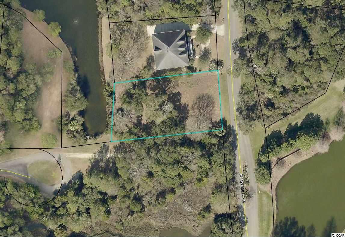 If you are looking for a homesite with pond frontage, a private setting and fantastic moss draped oaks - look no further. This near half-acre lot with wonderful 6 acre pond frontage is conveniently located in DeBordieu's golf course community with easy access to the Clubhouse, Oceanfront Beach Club, Fitness & Tennis Center and Boat Landing. DeBordieu Colony is an Private oceanfront community located just south of Pawleys Island, South Carolina featuring private golf and tennis, saltwater creek access to the ocean, a manned security gate, and luxury homes and villas surrounded by thousands of acres of wildlife and nature preserves.