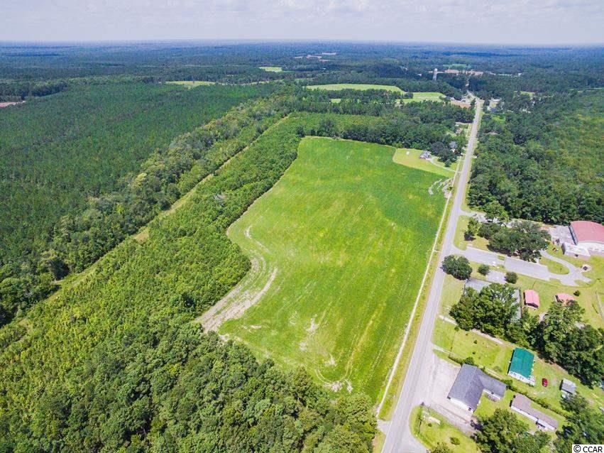 Bucksport... Conway area.. 36 acres... Perfect Location for Farm, Ranch, Mini Estate or Development. This property has a Mixture of Cleared and Wooded Land.  Paved Highway Road Frontage. Water and Sewer is Available on Bucksport Rd.  Across from the Waccamaw River and Horry County Recreation Facilities.  Bucksport Marina is just a couple of miles at the end of Bucksport Rd with access to Intra Coastal Waterway (ICW) and Waccamaw River.  Minutes to Shoppes, Dinning, Golf, Fishing, the Historic Conway Downtown River Front and the Most Beautiful White Sandy Ocean Beaches of the Grand Strand.