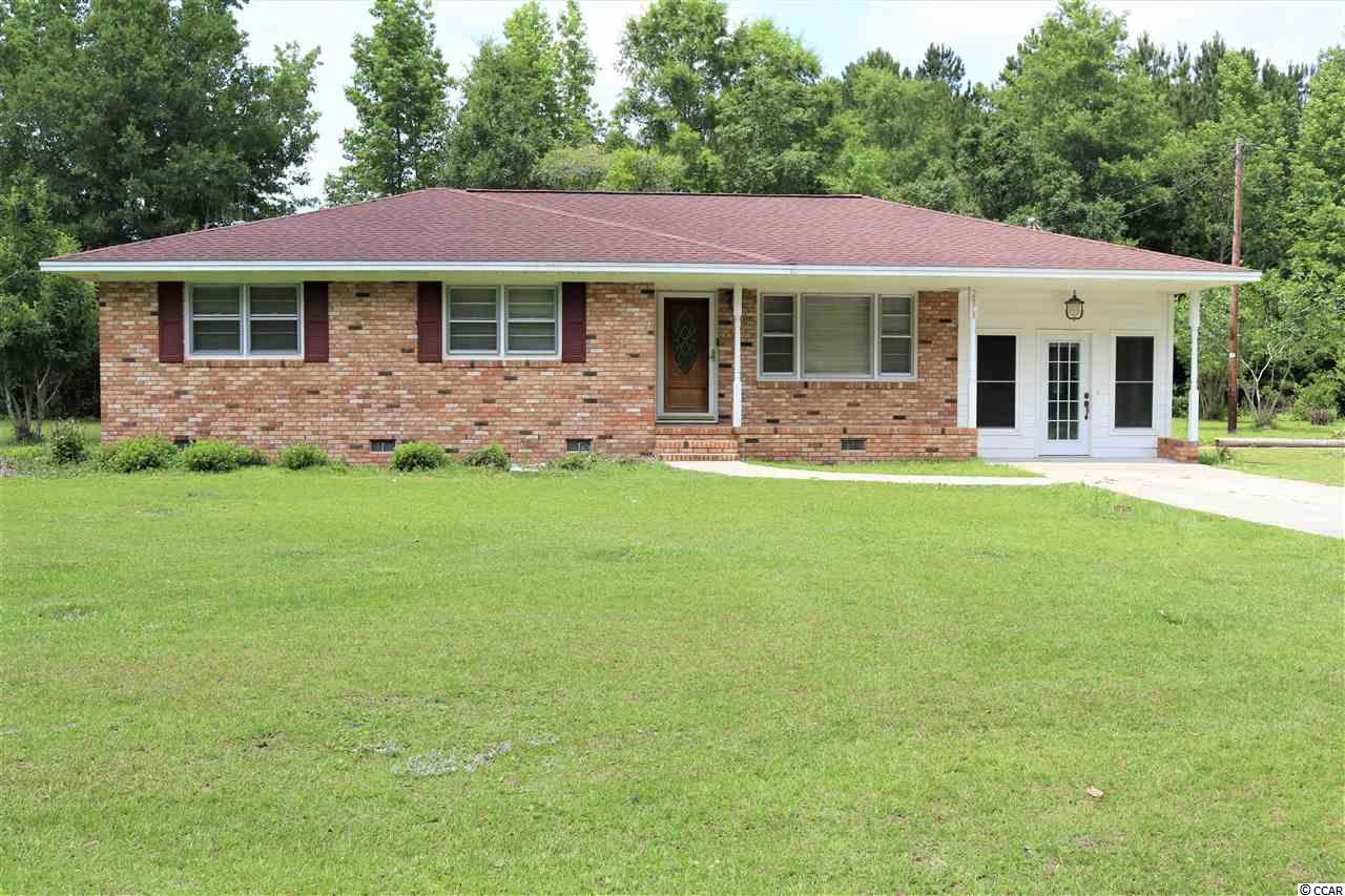 This 2BR/2BA home is located on .90 of a acre just outside the city limits in Conway. There is no HOA, if you're looking for plenty of room to put in a pool, plant a garden, park your RV, boat, trailer etc., this is the property for you! Home features hardwood flooring in living and dining rooms. Master bath has double sinks and tile flooring. LG eat-in kitchen with plenty of cabinets and sink with  instant hot water dispenser. The remote controlled gas fireplace was originally constructed to burn wood so it can be easily converted back to wood burning. Even though the house was built in 1967, it was completely renovated and enlarged in 1984 with a 2nd full bath, family room, fireplace and side porch. The carport was converted to a sunroom in 2012 with tile flooring, windows and 2 doors. New heat pump installed in 2014. Roof was new in 2010. Located one mile from Walmart & shopping plaza. With easy access to Hwy 501 or Interstate 22 you can get to Myrtle Beach in minutes!