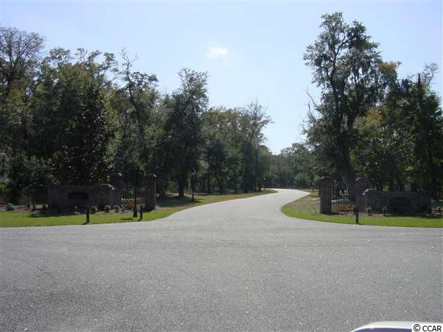 Nice wooded homesite in exclusive Island Estates on a quiet cul-de-sac overlooking Historic Ricefields with creek access to the ICW in The Reserve. Build your dream home! LBTS amenities.