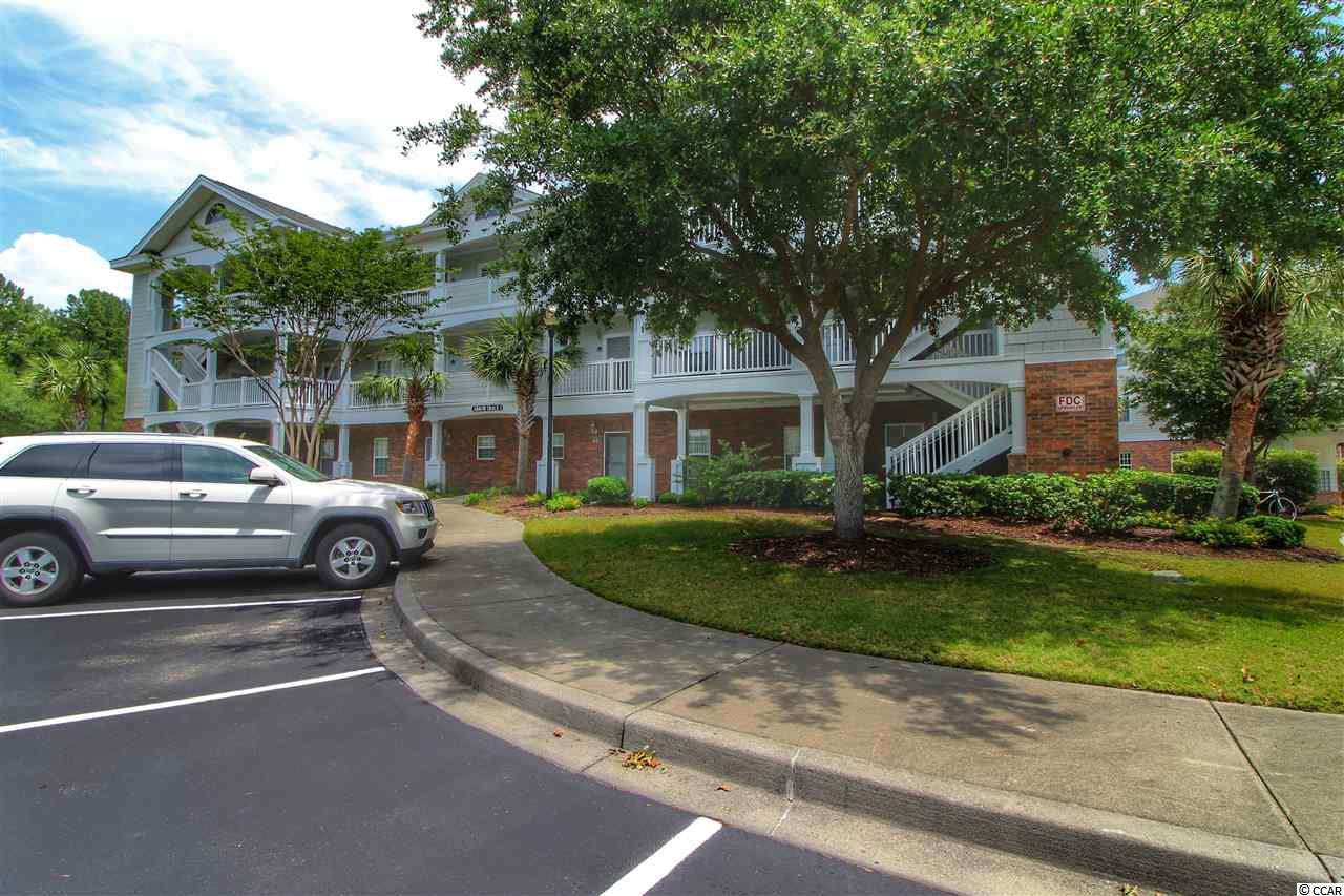 A FULL GOLF MEMBERSHIP CAN BE PURCHASED AT A REDUCED  RATE SAVING YOUR CLIENTS THOUSANDS. You will love this beautiful top floor unit in the Arbor Trace sub division located in prestigious Barefoot Resort. The unit is like brand new and never been rented. Actually the owners have used it very little. It has 2 bedrooms with 2 baths and offers 1000 heated square feet. Best of all it comes completely furnished down to the pots and pans. All you need are your personal items to move in. The unit is very quite being it is on the top floor with no one over you. It also has vaulted ceilings in the living room and dining area and a tray ceiling in the master bedroom. The kitchen is large with plenty of cabinets and countertop space. A large opening looks from the kitchen into the dining and living room. Off from the living area is a large balcony with views of the Norman golf course. The HOA dues offers one of the best deals on the entire Grand Strand. The dues include insurance on the building, wireless internet, basic cable, maintenance on the building, water and sewerage, trash, all management, landscaping, use of recreation facilities, membership to the Barefoot Beach Cabana with private access and parking, and finally use of a 15,000 square foot pool directly on the intracoastal waterway. Barefoot Resort also offers a marina with boat slips, jet skis, and pontoon rentals. No other resort offers so much and is just minutes to the ocean and other major attractions. Hurry!