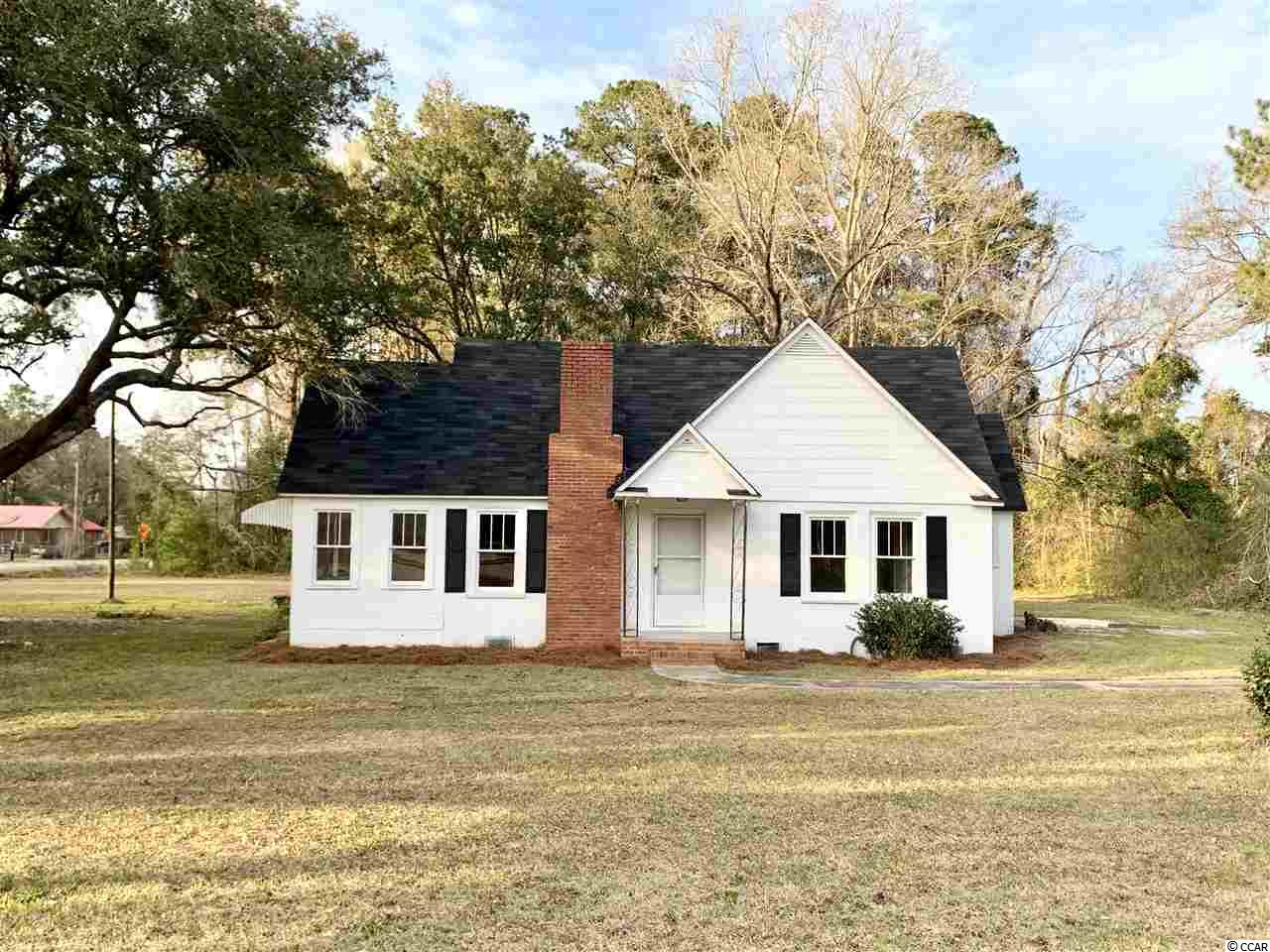 Large corner .99 acre lot with 200' of frontage on HWY 521. Lot has two driveways one on Greentown Rd and one on HWY 521. 5 min. drive to downtown  Georgetown  Home has new HVAC and roof. Interior features have been updated. Agent is owner.