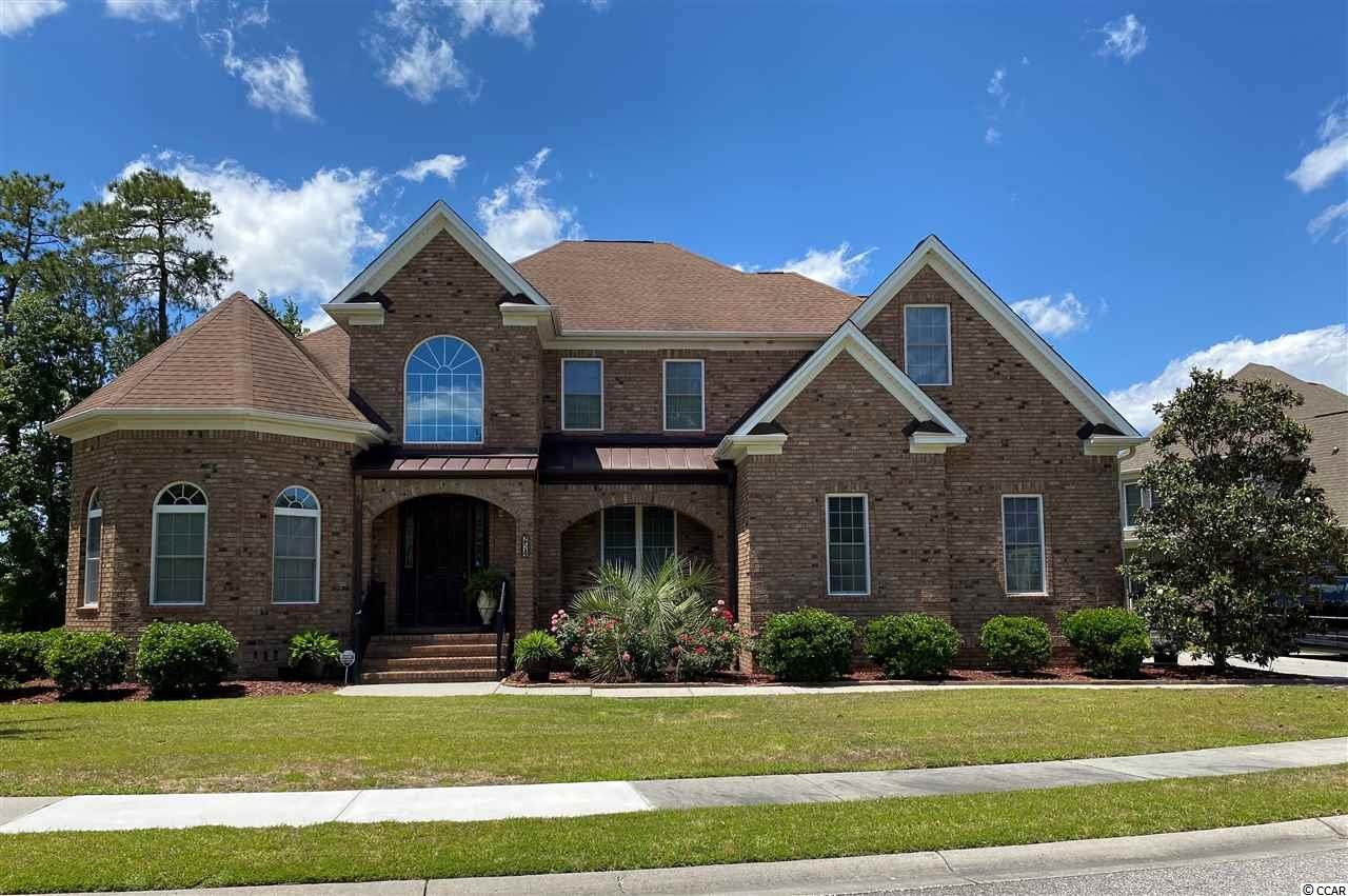 Meticulously cared for, 1 owner home, with lake view.  Experience life in the beautiful, prestigious community of Plantation Lakes, with over 170 acres of land surrounded by lakes and ponds.  This community boasts some of the areas most beautiful custom-built homes. Find yourself relishing the luxury of this well cared for, all brick custom built home, constructed with 4x6 beams.  As you walk through this home, you will delight in Brazilian cherry hardwood floors, cathedral ceilings, 20 ft plus entry, and custom-made front door.  Be a gourmet chef in the spacious kitchen with granite countertops, custom cabinetry, Viking appliances and gas range.  Then serve your delicious dinner in the formal dining room with an exquisite antique crystal chandelier from Austria. There are two tank-less gas hot water heaters, allowing instant and boundless hot water. As your evening ends, curl up in front of the gas fireplace or sit on the beautiful brick deck while taking in the view of boats as they cruise the lake.  This home is wired for sound system throughout. It offers 4 separate attic storage spaces.  The front parlor is an excellent room to read as well as the perfect room to grow multiple plants.  There is an upstairs Master bedroom and a downstairs Master bedroom suite. Overall, the home has 6 bedrooms 3 full baths and 2 half baths. It features tons of extras such as lighting in closets, alarm system, French doors, extensive custom trim and molding, as well as ceiling fans and an attic fan. This home is perfect for entertaining or simply reveling in the Carolina lifestyle.