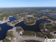 Beautiful Lake Front Lot in the gated community of Waterbridge. This lot is located in a beautiful , private, peninsula with nearly 105FT of water frontage. Enjoy the wonderfully serene setting of this location! All the homes are custom built with the builder of your choosing. There is no time frame to build. Amenities include an stunning pool and amenity center, fitness center, walk down fire pit, swim up refreshment bar, tennis courts, volleyball and basketball courts,  boat ramp and pier. Located in the heart of Carolina Forest.  Easy access to all Myrtle Beach has to offer!!!