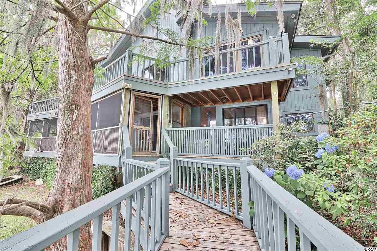 Spectacular Riverfront location. Amazing Views. Directly on the Waterfront of the Waccamaw River with 200' of frontage. Listen to the water on the shoreline. Vaulted Ceiling bounds the first floor Great Room. Beautiful Heart Pine floors and Brick floors throughout the spacious living areas. Red cedar Built-in cabinets surround the 2 grand fireplaces. Attached 2 car garage with large laundry/mud room, Large decks and porches overlooking the water.   The private dock features a covered fixed pier head with running water and electricity, 100 amp power station hook up, with dockage capacity for up to a 70' yacht. Enjoy the cruising Yachts of the Intracoastal Waterway. Relax and enjoy the panoramic views of the River overlooking  the historic rice fields bringing the outdoors into your living room.  Much more than just a gorgeous home, the location is perfect- just an hour north of Charleston and a half hour south of Myrtle Beach! Convenient to Brookgreen Gardens, Murrells Inlet Marshwalk, Huntington Beach State Park, the beach at Pawleys Island, and wonderful area restaurants and quaint shopping venues.  Located on a high river bluff with no history of flooding and has a beach by the water. A Must See!! Call for your private tour today.
