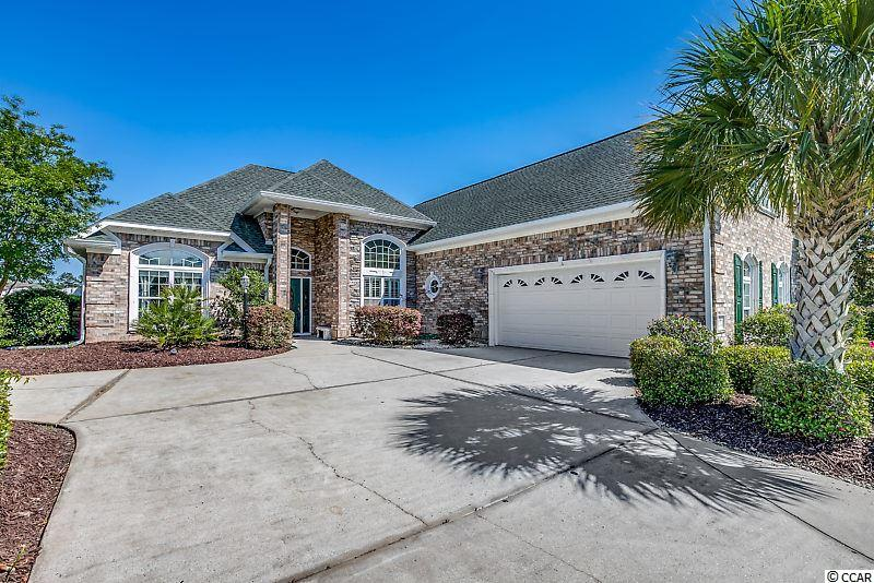 NEW PRICE!  Rare find in community! 4BR/3BA custom brick home on lake in beautiful gated community of Waterfall in Little River! Split floor plan with 1st floor master and 4thBR/Bonus upstairs with private full bath. Upgrades galore including: crown molding, arched entryways, built-in 15ft buffet cabinetryw/ granite countertop in DR, security system, vaulted and tray ceilings throughout, recessed lighting, teak hardwoods and ceramic tile flooring throughout. Screened porch and oversized patio area to enjoy direct 8 acre lakefront views. Huge Carolina room with atrium window. Tinted windows and hurricane code rated. Custom Del Mar cabinetry in kitchen with island and breakfast bar. Also tiled backsplash, granite countertops, stainless steel appliances, and huge pantry! Come see all the wonderful amenities this community has to offer - beautifully decorated clubhouse w/ fitnesscenter, pool, and outdoor grilling area! Community located just off new Main St connector and Hwy 31 and the new North Myrtle Beach Recreational Park with soccer/baseball fields, walking trails, and outdoor concert venue.  Jump on Main Street Connector for dining and shopping in minutes.  You'll be on the ocean in 5 minutes!  New hot water heater & roof 2017.  New 18-seer Dankin HVAC w/air filtration 2018.  Square footage is approximate and not guaranteed.  Buyer and buyer agent is responsible for verification.