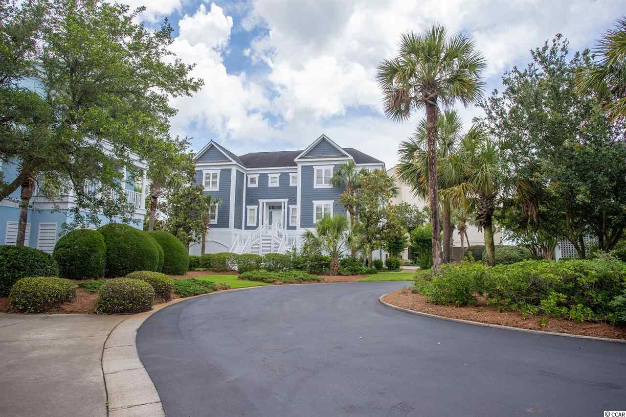 Located in Charlestowne Grant, an exclusive community in Litchfield by the Sea, this home offers private beach access and 24 hour security along with lighted tennis courts, fishing and crabbing docks, access to a private ocean front clubhouse and more. Ocean and marsh views are available in this home, and it's just steps from the beach and pool! In addition, it's a few minutes from dining in Murrells Inlet, award winning golf courses, marinas, shopping and Brookgreen Gardens, yet it is close enough for a day trip to Charleston, Historic Georgetown or Myrtle Beach. This home has never been used as a rental and was built and occupied by a contractor. With this home you can enjoy a security, hardwood floors, high ceilings, plantation shutters, and crown moulding throughout. The entry level presents a dining room, living room, office, kitchen, laundry room and sunroom. The living room features a beautiful fireplace with gas logs and custom cabinetry. On this level you'll also find a large master suite with a separate sitting area and it's own bathroom with a whirlpool tub and double sinks. Once on the upper level, you'll see 3 more bedrooms, 2 bathrooms, and a 2nd master suite complete with ocean views, a sunroom, outdoor porch, 2 walk-in closets, and bathroom with a whirlpool tub and dual sinks. An added bonus is a brand new A/C on this level. This home comes elegantly fully furnished and is an incredible offering with a 6-car garage. Square footage is approximate and not guaranteed. Buyer is responsible for verification.