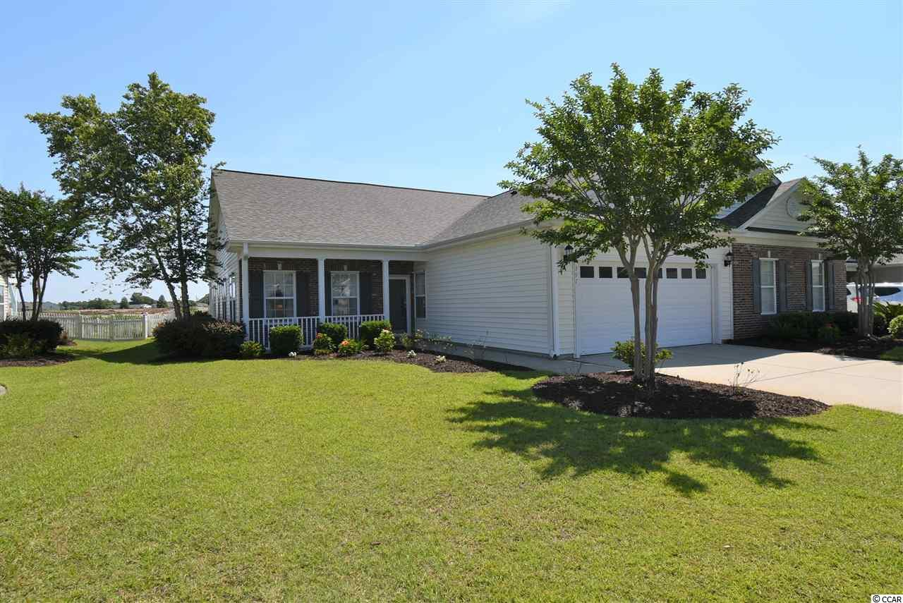 Immaculate & Spacious Paired Ranch in the desirable Deerfield Links community with Pool located EAST of the Bypass 17! Home offers 2 bedrooms, 2 full baths (Master bedroom has walk-in closet, linen closet and private bathroom with 2 sink vanity and 2 seat low threshold shower and guest bath has Garden Tub/shower combo), large sunny Carolina Room with two sets of Double French Doors, Large Dining Room area, Huge Kitchen with Corian countertops, Pantry and GE Profile appliances, Cathedral ceilings, Ceiling Fans, Laundry Room with folding counter & storage (washer & Dryer negotiable), Huge 2 car garage with plenty of shelving, Hurricane Shutters, beautiful back yard with Patio and Fencing. Quiet setting on the pond. This is a larger than average layout in Deerfield Links. Home is a PAIRED RANCH...NOT a condo. HOA fee includes ALL exterior insurance of structure, all exterior maintenance (except doors and windows), landscaping & Lawn Maintenance (except inside fenced areas), irrigation, water & sewer, Basic cable, Internet, Trash pickup, Pest Control, Termite Treatment, Deerfield Links Drive & street light maintenance and Pool. Home has Hurricane Shutters that offer an Insurance Discount (see attached associated docs). Fenced back yard (new owner can add small section between next door neighbor if they so desire... Yard is fenced but because the next door neighbor was a relative they did not add the separation fencing between the two yards... (new owner can add small section between next door neighbor if they so desire but must match existing- see hoa). New roof installed in February, 2020! Don't miss out! Make an appointment to see.