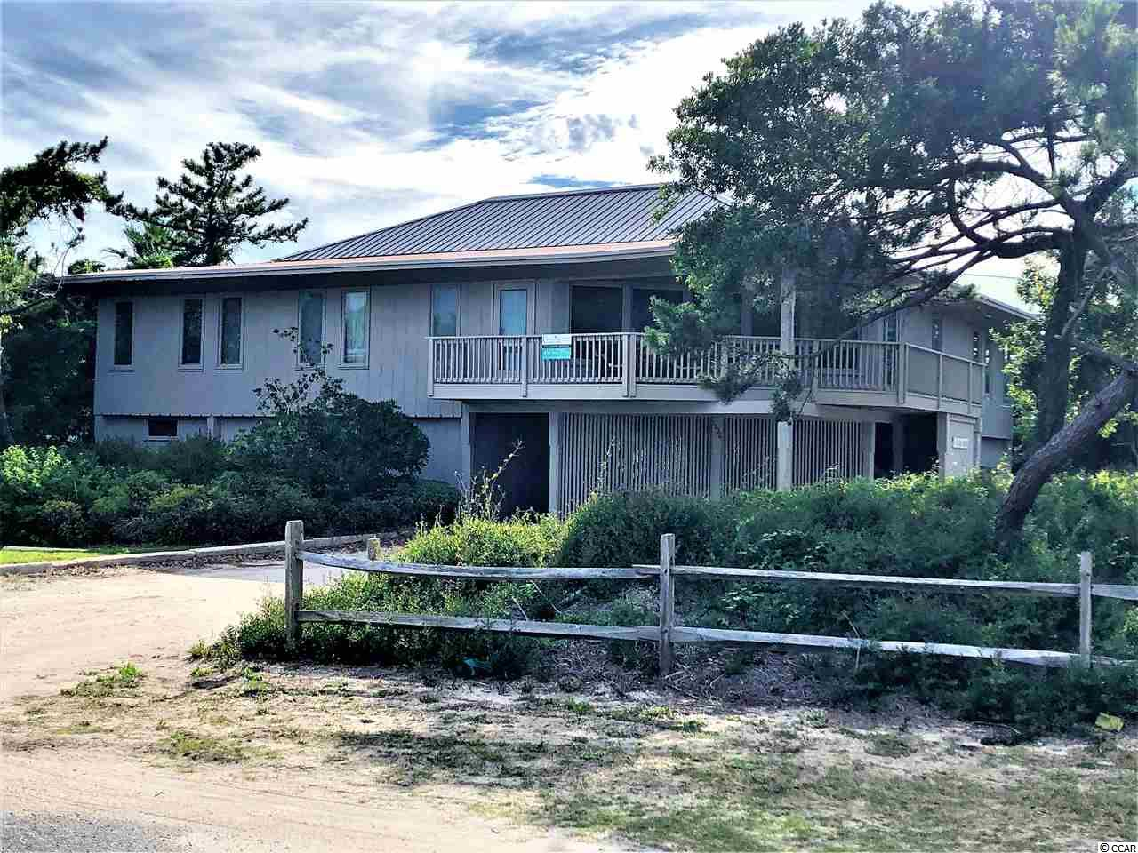 One block from the ocean with water access to the inlet, this one of a kind, five bedroom beach house is waiting for some new memories to be made.  Home is situated on a large corner lot with mature trees and greenery.  A large party pad underneath the home with two bedrooms and a bath, plus outdoor shower, utility/storage closet, and plenty of space for outdoor entertainment.  In the back a small dock providing opportunity for a boat to reach the inlet/ocean.  Upstairs is a unique floor plan with three more bedrooms, laundry room, wet bar, living room, kitchen and dining area, and a large wrap-around indoor outdoor deck.  Off the living room on the ocean side is another deck to enjoy the sunrise.  Just a short stroll to the beach access at the end of Pompano Dr, or a short boat ride to the inlet for some fun on the water.  Don't miss this opportunity to own a truly unique property that's ready for your personal touch.