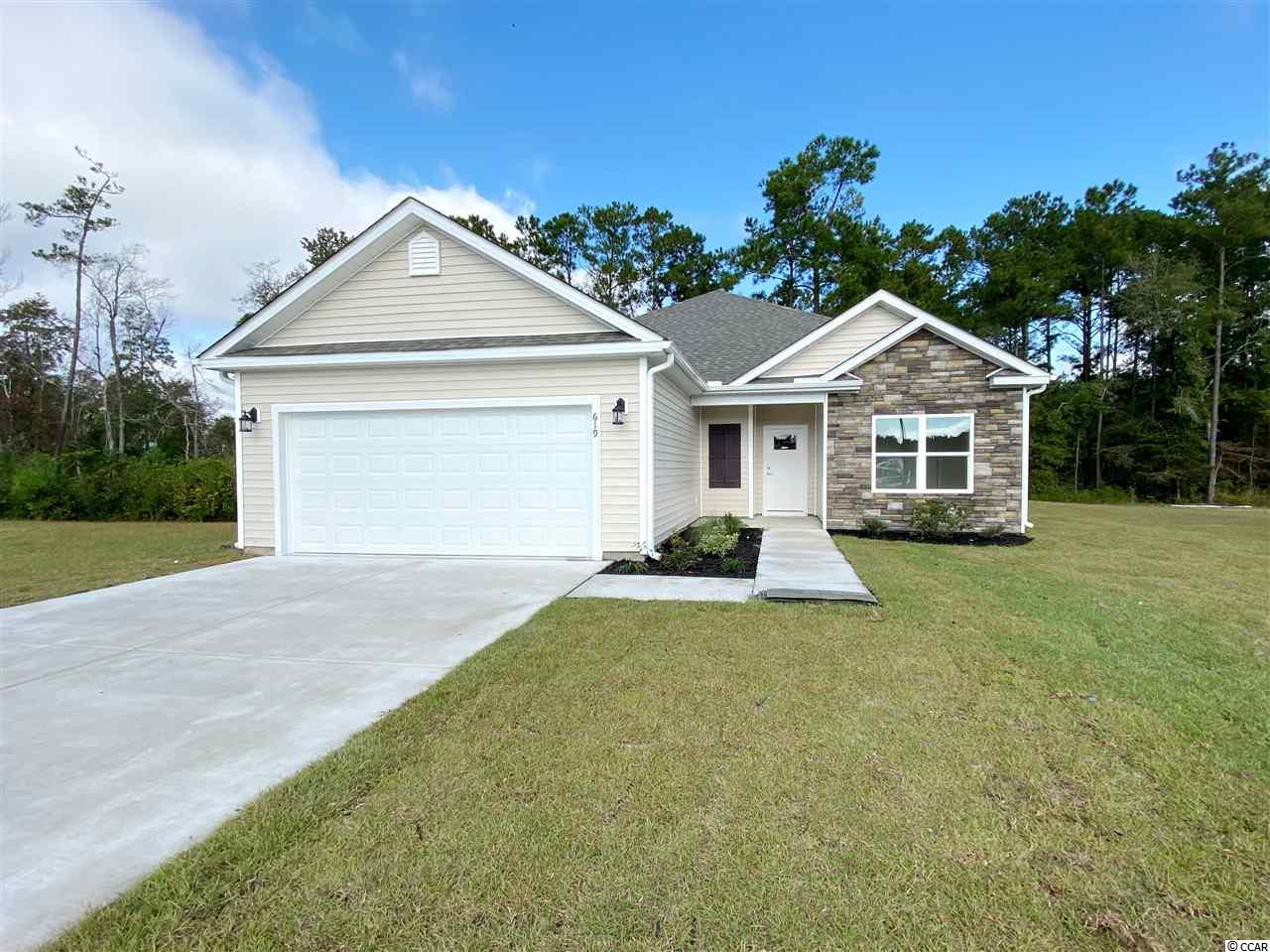 New Constuction Community in a prime location right next to International Blvd and Highway 22. Conveniently located to some of the finest dining, shopping, golf, beaches, schools, hospitals, and downtown Conway, Myrtle Beach, and North Myrtle Beach. Be the first to own this Carson, model with a spacious open floor plan of the main living areas, with vinyl plank flooring and crown molding throughout. The kitchen comes with stainless steel appliances, upgraded soft close cabinets with granite countertops, a gas range, large work island with a breakfast bar, and pantry for extra storage. The master suite includes double sink vanities and two large walk-in closets. Each bedroom includes a ceiling fan and plenty of closet space, with easy access to the second bathroom. Other features include 9' ceilings on the first floor, an optional gas HVAC system, tankless gas water heater, wifi thermostat, and much more. The Reserve at Heritage Downs will include a large lake with walking trails around it, and large open recreation areas for kids to play. Stop by the model home for more information and ask about the new community and other model homes, upgrades, POOL options. Yes! You can have a pool in your very own back yard.