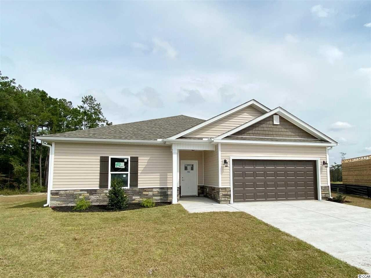 Located in a prime location right next to International Blvd and Highway 22. This new upscale natural gas community is conveniently near to some of  finest dining, shopping, golf, beaches, schools, hospitals, and downtown Conway, Myrtle Beach, and North Myrtle Beach. The Sean, two story model with a loft features a spacious open floor plan of the main living areas, with LVP flooring and crown molding throughout. The kitchen comes with stainless steel appliances, upgraded soft close cabinets, granite countertops, a gas range, large work island with a breakfast bar, and a pantry for extra storage. The master suite includes double sink vanities and two large walk-in closets. Each bedroom includes a ceiling fan and plenty of closet space, with easy access to the second bathroom. Other features include 9' ceilings on the first floor, an optional gas HVAC system, tankless gas water heater, wifi thermostat, and much more. The Reserves at Heritage Downs will include a large lake with walking trails around it, and large open recreation areas for kids to play. Stop by the model home for more information about the new community, other model homes, land home packages, upgrades, POOL options. Yes! You can have a pool in your very own back yard.