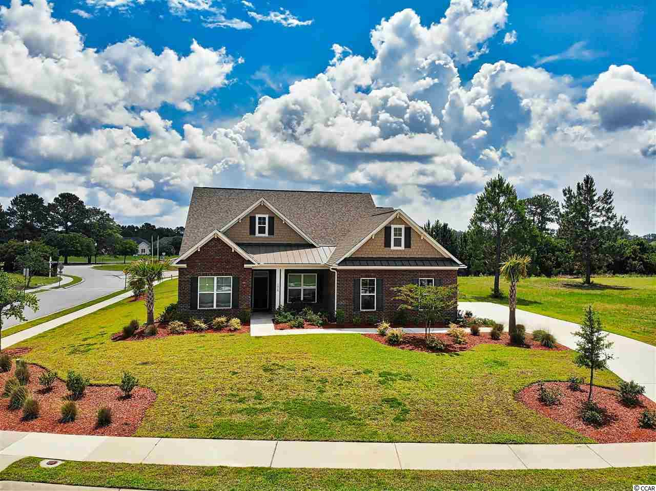 Must see this 2 year old 3br/2ba home w/ den/office/bedroom, on a corner lot in the golf course community Wild Wing Plantation! This great home w/ over 2,400 htd sqft on a half acre lot features an open floorplan with hardwood floors throughout. Large formal dining room for family get- togethers has coffered ceiling. Gourmet kitchen w/ stainless appliances & granite countertops, double wall oven, tilebacksplash, breakfast bar, breakfast nook, work island, and pantry. The family room/greatroom has cathedral ceilings with a wood beam and a gas fireplace with buildt-ins on either side. It also boasts a master suite w/ tray ceiling & large walk-incloset. There is a large utility room, separate den/office, screened porch and side load garage with pull down stairs to attic! On topof this fantastic newly built home, Wild Wing Plantation is a Natural Gas Community featuring great amenities including 180 acres of lakes, a golf course, driving range, clubhouse w/ fitness center, 3 awesome pools, a water slide and kids area, basketball &tennis courts, day docks, a boardwalk and is conveniently located close to the schools, CCU, Conway Hospital, downtown Conway, and just a short drive to a MB Airport & all of the shopping, dining, entertainment, golf, area attractions, the beautiful Atlantic Ocean w/ 60 miles of white sandy beaches and all the beach has to offer yet is out of the busy hustle & bustle of the Grand Strand!Don''t Miss ~ Come Live the Dream!