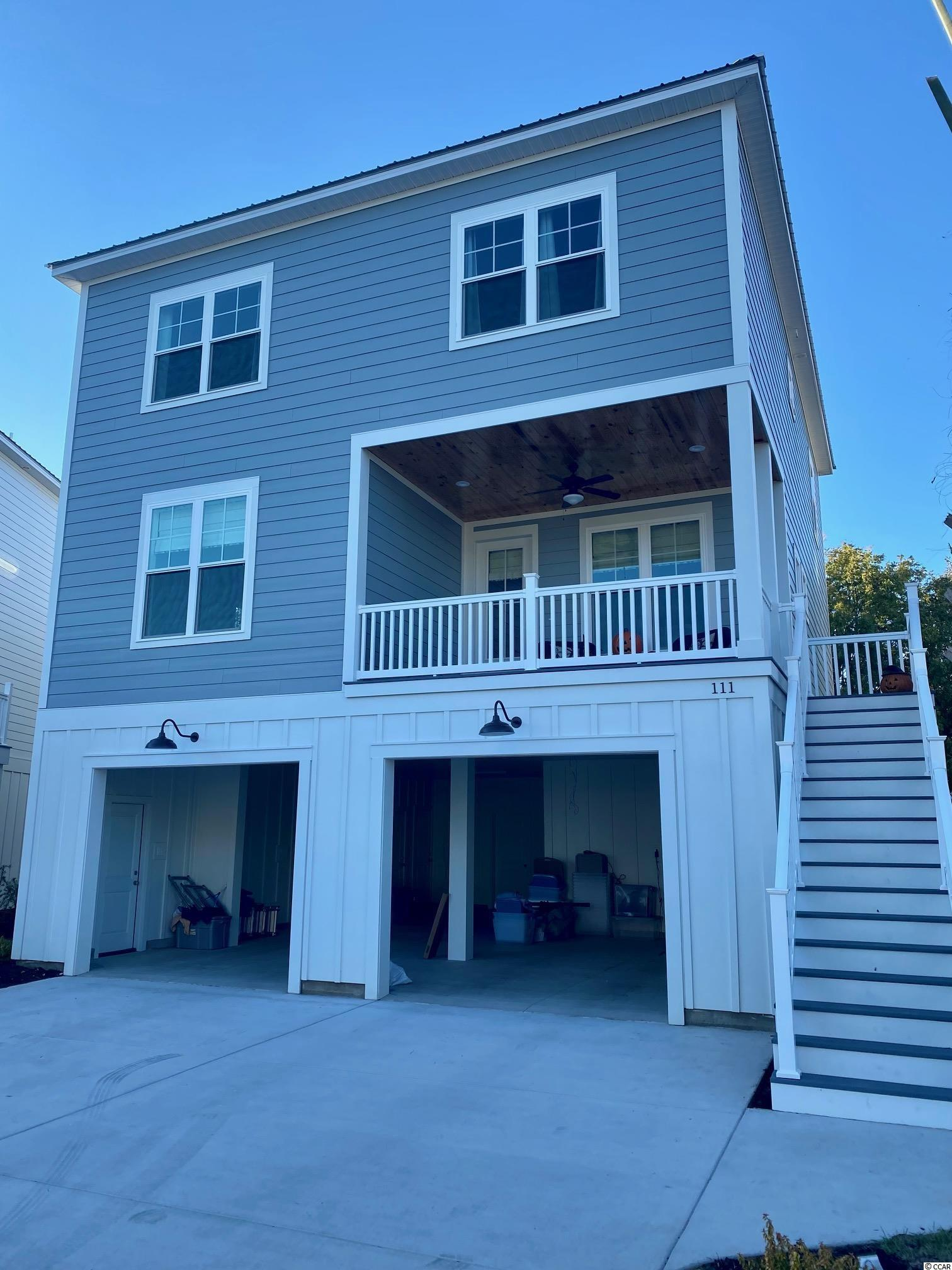Beautiful new construction custom floor plan. This raised BRAND NEW beach style home offers 4 bedrooms and 3.5 baths and an upgraded flooring package to include Water Proof Vinyl Floors and Carpet. Parking and plenty of storage underneath and a beautifully landscaped yard. This neighborhood features a community pool and dock for inlet fun! This home is perfect for the Pawleys beach bum that doesn't want to pay the high prices on Pawleys Island!