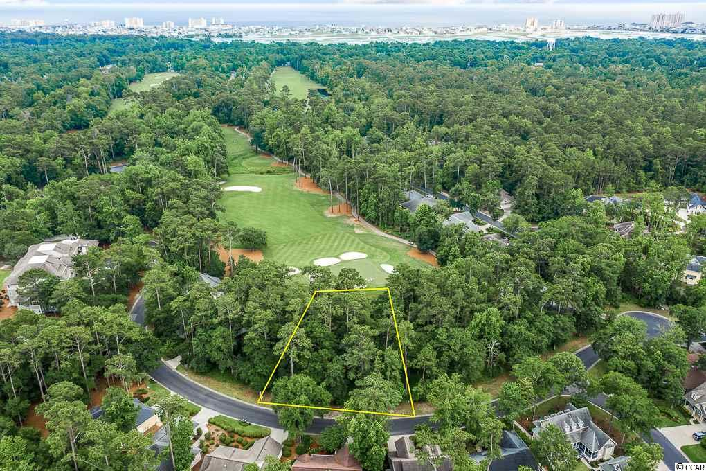 Ready to build your dream house? Check out this beautifully matured lot located directly on the golf course in the well established and sought after community of Tidewater Plantation. Situated on the green of hole number 7 is this pristine 0.26 wooded acre lot located on Lighthouse Dr. Sit back, relax and watch the golfers play all day! As part of the city of North Myrtle Beach, this lot has city utilities readily accessible at the street like water, sewer, electric. Located only minutes from the beach, shopping, restaurants, parks and all the best of North Myrtle Beach, SC. Tidewater plantation is a private, gated community with 24/7 security nestled between the intracoastal waterway and Cherry Grove Inlet. It is a very active community and the lucky residents have a variety of recreational and social amenities. Featuring a total of 5 pools, a newly remodeled fitness and exercise center with state-of-the-art equipment, tennis courts, amenity center, restaurant, oceanfront beach house cabana and the award-winning golf course. The clubhouse, pools, and tennis courts are located within walking distance from this lot. This one of a kind beach house cabana is in Cherry Grove only 5 minutes away from the community and directly oceanfront making your beach days a breeze. It has gated parking, elevator, screened in porches, sun decks, kitchen, and separate changing rooms. Tidewater golf course has received multiple national publications and high reviews from the critics since opening. The residents plan many group activities on and off the property and have various social clubs for like interest. They even have a group that participates with charities and they host a very successful charity golf tournament each year. This gorgeous lot is in the Tidewater Plantation neighborhood which is privately gated and located along the golf course and quaint Intracoastal Waterway. Living at Tidewater Plantation is a lifestyle and there is no other lot like this one, you don't want to 