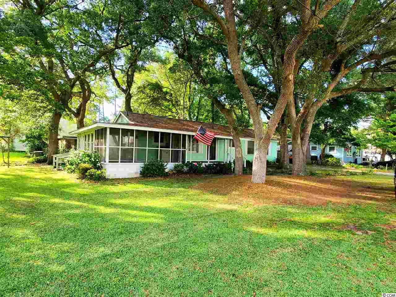 WOW!!  Here is the chance to own a charming home with tons of character.  Being one of the first homes built in Surfside beach, this home has made it through everything!  Just imagine if these walls could talk!  Walking distance/golf cart distance to beach, restaurants along Surfside Drive and at the beach, and much more!  The mature trees and oaks that shade the lot on hot summer days add so much charm and beauty to this perfect beach cottage.  Need an affordable Surfside Home?  Here it is, don't wait!