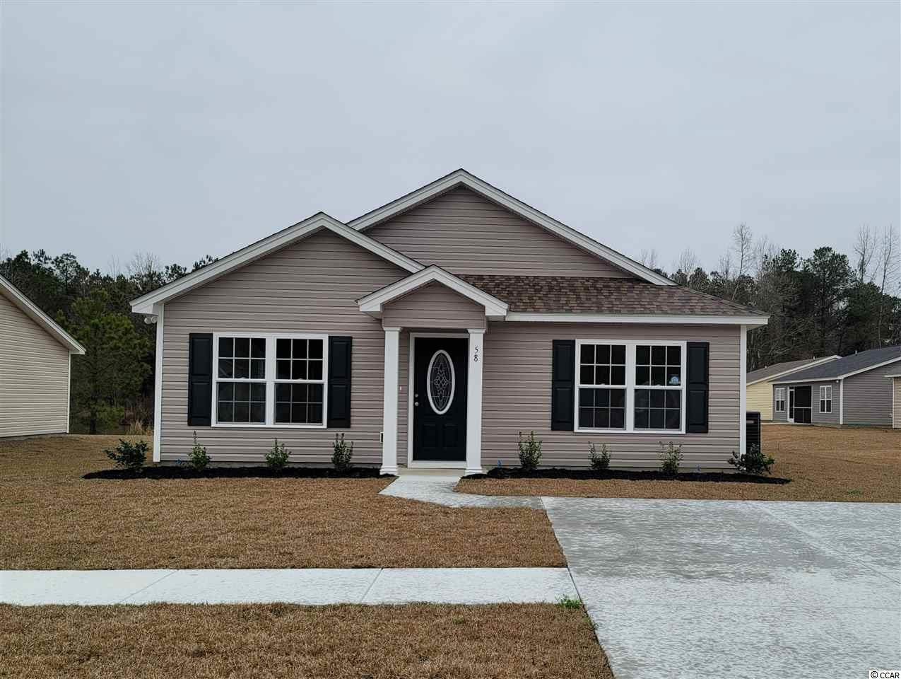 The St. John Model is a one level home with 3 BR 2 Bath, 1200+/- heated sq. ft.  with an open floor plan that features a spacious and comfortable kitchen overlooking the living room. This home feature includes but are not limited to: Low Maintenance Exterior Vinyl Siding. 30 Yr - Architectural shingles , Low E- Vinyl windows. Open Kitchen with Stainless Steel Appliances, Spacious Bedrooms,  5 ft. walk-in shower in Master Bathroom -  cultured marble vanity top in bathrooms. Pictures are of a similar plan model home and are for illustration purposes only. Beverly homes offers home customization and floor plan changes. Georgetown Estates is a premier community conveniently located along HWY 521,  easily access both  downtown Andrews and the Historic Georgetown, SC.  sidewalks wind throughout the community.  Huge oaks and beautiful mature trees surround this gorgeous new community. Come experience the beautiful and sweet life that the low country of South Carolina and Georgetown Estates has to offer! Beverly Homes is a equal opportunity Builder.