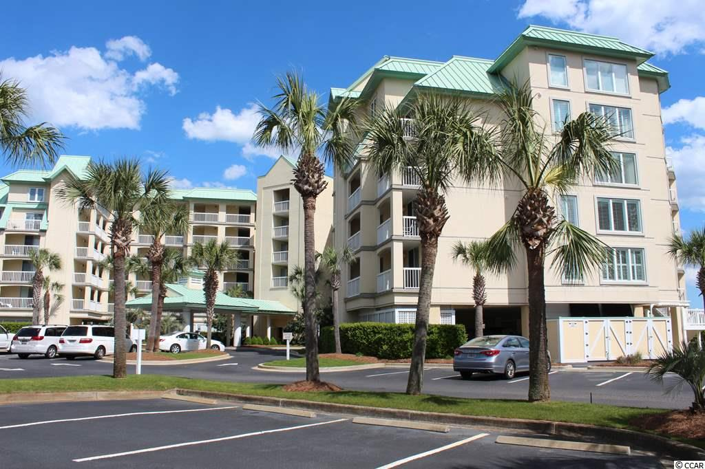 Oceanfront on the 4th floor of The Cambridge, in the Somerset community at Litchfield by the Sea. Fantastic view of the beach and ocean. Nicely furnished, fully equipped for your vacation home at the beach. Featuring 3 bedrooms, 3 baths. Living area opens to a spacious oceanfront balcony. There is a wet bar in the dining area, and the kitchen has a breakfast bar. The large master suite also opens to the oceanfront balcony with view of the pool area to the beach and ocean. The master bath has a garden tub and walk-in shower and vanity with two sinks. Split bedroom plan has two guest bedrooms and two guest baths off the entrance hallway. Enjoy coastal life at its best! Litchfield by the Sea offers the best amenities in the area. Walking/jogging paths, fishing lake with a pier, a marsh overlook with a floating dock, tennis courts, oceanfront clubhouse with sundeck, and guard gate entrance.