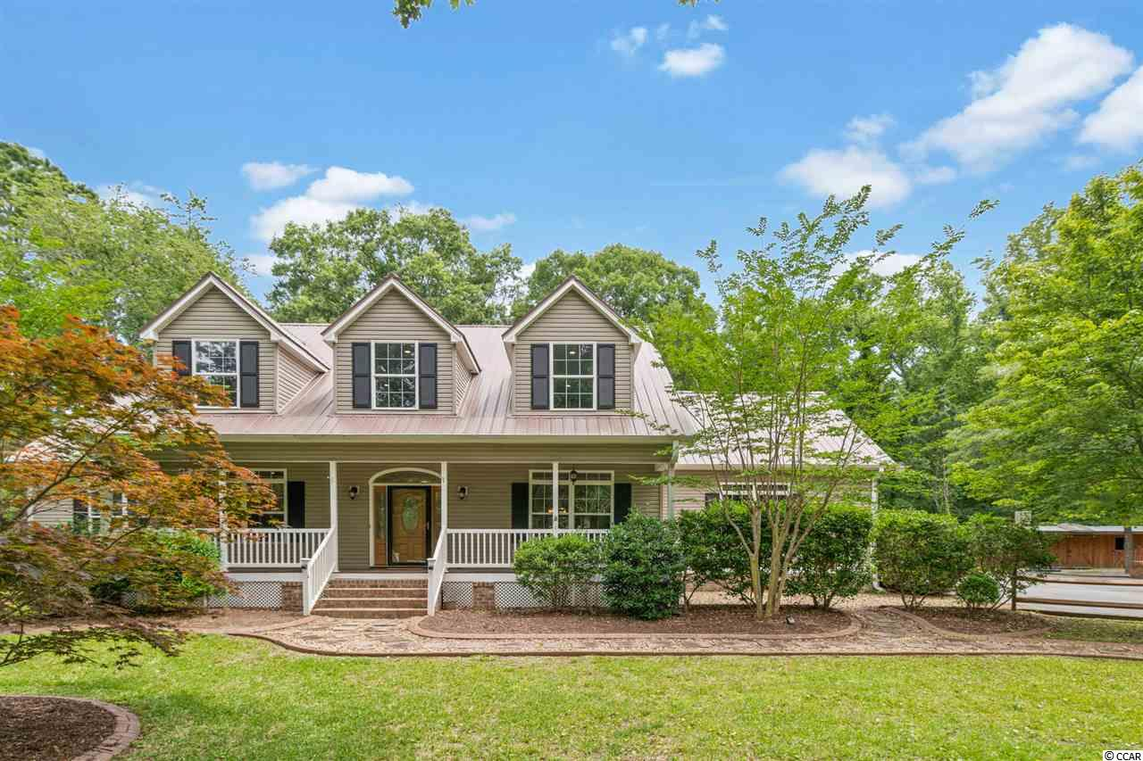 Come see this treasure off McDowell Shortcut Rd in beautiful Murrells Inlet! A rare find, this large, 5br-3ba, 4,580-sf home offers no HOA in a fantastic location, less than 5 miles from the beach, the Marshwalk, golf, shopping, churches, the hospital and more and is within walking distance of the award-winning St James schools.   Some exterior highlights include 1.94 acres, a privacy tree-buffer, landscaped areas with irrigation, a 330-sf workshop w/ wood stove, horse barn w/ solar powered lighting, training pin, chicken house, firepit, split-rail fencing, and a paved drive with space for boat parking. A house-wide front porch welcomes guests indoors into a spacious split floor-plan with foyer, an inviting wood staircase and an extra large great room. The well-equipped kitchen features granite, drop lights, island, pantry, work-desk, brand new appliances, under-cabinet lighting & breakfast nook. Knock out the rest of your house-shopping list with office space, formal dining room, 3 downstairs bedrooms, luxurious crown molding, recessed lighting, arched doorways,  walk-in closets, walk-in laundry, shop space and so much more. The upstairs space includes two additional bedrooms, a full bath, and multiple roomy and airy common areas with room-height dormers, perfect for home theater, gym, recreation and play room or guest quarters. Floors are a mix of hardwoods, tile, carpet and LVP. New Roof and HVAC in 2017.   Murrells Inlet is the gem of the Grand Strand and is perfectly located just 20 minutes south of the hustle and bustle of Myrtle Beach and about 1.5 hours north of Charleston.