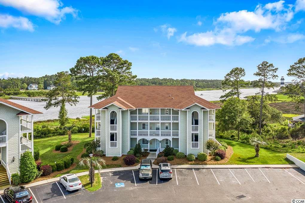Check out this gorgeous condo with panoramic views of the intracoastal waterway located in the well landscaped golf neighborhood of Eastport. Unit F-4 is a spacious end unit on the second floor of building 4628 in the quaint community Spinnaker Bay East. The condo is in pristine condition and was never rented. Featuring 2 bedrooms and 2 bathrooms with a large balcony overlooking the lighthouse and waterway. Walk up the stairs and the door opens into the foyer of the condo with beautiful wood flooring. The kitchen is off to the left with a teal accent back splash and white appliances plus a pantry with plenty of shelving. There is also a breakfast bar overlooking the dining area featuring a beautiful picturesque window and a built in shelving space with cabinets. The living room features crown molding, carpeting and a ceiling fan with access via sliding glass door to the balcony. The private screened in balcony is a good size and the perfect spot to relax and unwind as you watch the boats sail away in the waterway. The views from this balcony are some of the best views in Little River. This balcony can also be accessed via sliding glass door from the master bedroom as well. The master bedroom features crown molding, carpeting and a ceiling fan with on suite bathroom. The bathroom has a separate sink and vanity from the tub/ shower and toilet area. The second bedroom is located at the entrance of the condo and has a bathroom with a tub/ shower combination. There is also a washer/ dyer that conveys with the condo and a large outside storage unit. An additional storage unit can be rented. Spinnaker Bay East is a quaint condominium community located inside of the golf neighborhood of Eastport. Conveniently less than 10 minutes to the beach; perfect for an investment property, second home or primary residency. This condo is beautifully landscaped and features sidewalks and plenty of parking. Amenities include a pool, hot tub and restrooms and then in Eastport an additiona