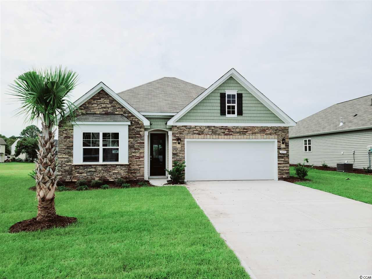 "You do not want to miss out on this home! Our Claiborne plan is the perfect  open concept, single story home with four bedrooms! The kitchen features granite countertops, an oversized island, 36"" white painted cabinets, a walk-in pantry, and stainless Whirlpool appliances. Large owner's suite tucked away at the back of the home, separated from the other bedrooms, with a double vanity and 5' shower in the master bath along with a huge walk-in closet and separate linen closet. Beautiful laminate wood floors flow throughout the foyer, kitchen, living, and dining rooms with tile in both bathrooms and the laundry room. Spacious covered rear porch adds additional outdoor living space with water views! This is America's Smart Home- ask an agent today about our industry leading smart home package that is included in each of our homes. The Retreat at Ocean Commons offers proximity to Surfside Beach, Murrells Inlet, and all the shopping, dining, and entertainment in the nearby Market Commons. Natural gas, golf cart friendly community that is only 1 mile to the beach! Come see our furnished model home of this same floorplan! *Photos and virtual tour are of a similar Claiborne home. (Home and community information, including pricing, included features, terms, availability and amenities, are subject to change prior to sale at any time without notice or obligation. Square footages are approximate. Pictures, photographs, colors, features, and sizes are for illustration purposes only and will vary from the homes as built. Equal housing opportunity builder.)"