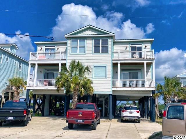 Crabby Cabin B is a marsh front, semi-detached beach house. It features 5 bedrooms and 5.5 baths. Enjoy beautiful views of the pier, ocean and marsh. With two balconies on the front of the home and two one the back…pick your spot and enjoy the ocean breeze and water views. If you are ready to cool off even more, take a dip into the private, marsh front pool. This home is a short walk to the beach and close to many restaurants and shopping. 225-B North Dogwood is your perfect opportunity for a beach vacation property!  Be sure to watch the walking video tour on my YouTube channel.