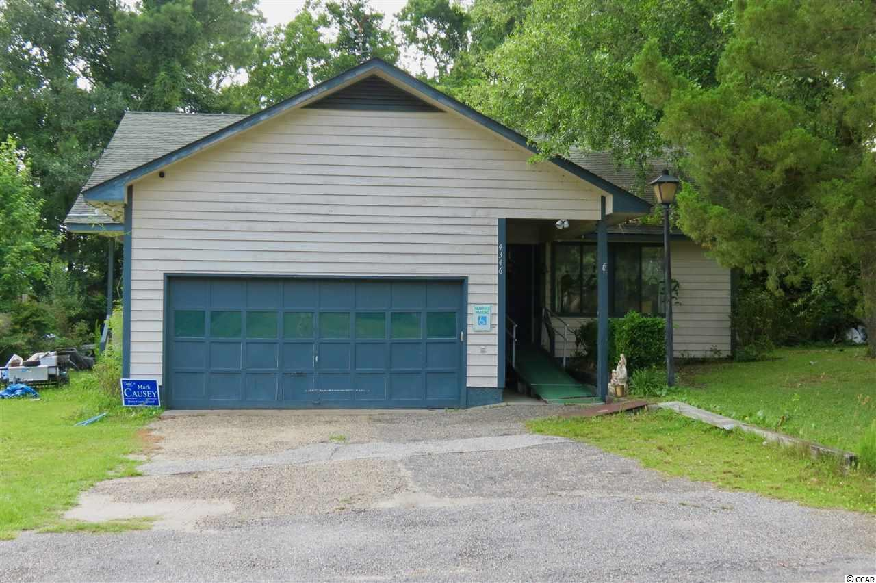 Charming 3 bedroom home on centrally located half acre lot in Little River. No HOA! Space for your boat and RV. Around the corner from the boat landing and intercoastal waterway. Open floor plan, vaulted ceiling, wood burning fireplace, bay window, breakfast bar, and a wet bar adjacent to the kitchen. Master bedroom includes a walk-in closet, with a bonus hot tub room located just off master bedroom. Solar panels power this home. Just a little TLC and this home will rise fast in value! NOTE: This home is being sold as-is. Square footage is approximate and not guaranteed. Buyer is responsible for verification. Located near North Myrtle Beach shopping centers, desirable North Myrtle Beach School District, and minutes from golf courses, medical centers, and North Myrtle and Cherry Grove Beaches.
