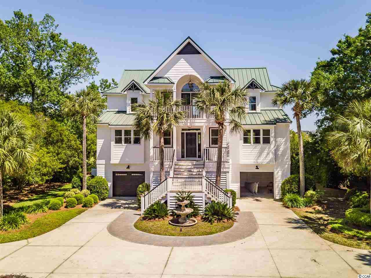 """Every once in a while a home and property comes on the market that perfectly describes Lowcountry Living & the Pawleys Island Lifestyle!  Are you an Avid Fisherman or boating enthusiast who wants access to both creek & deep water? Maybe your perfect morning includes sipping a cup of coffee from a rocker on the porch as you enjoy the sounds of all the surrounding wildlife. Enjoy a morning run or bike ride to the beach just 3 min from home. Experience Breathtaking Sunrises and Sunsets from the dock or porch areas daily! Water sports like paddleboarding, throwing a cast net, surfing, kayaking, & crabbing await ! Location is Everything & your piece of Heaven is tucked away on a peaceful and private setting just a short golf cart ride to the Beach & everything in Pawleys!  If you love great food Chive Blossom & Franks; two of Pawleys Island's best eateries, are a 1 min. walk from your home!  Welcome to 196 March Lane; affectionately known as """"Up the Creek"""" Nestled among Moss draped Live Oaks & airy Palms you will be so impressed as you enter the majestic Stone Wall & Iron Gated & Gas Lantern Entrance leading to an awesome sweeping staircase & fronted by a gorgeous stone tiered fountain. The grounds surrounding this Custom Home are spectacular! This estate sized 1 acre lot begs you to explore the creek! The Owner has spared no expense with a New Walk-out & dock constructed by C- Way; a local dock expert. Fish and relax at the Covered Dock as you make everlasting memories. The dock has a floater & there's nothing better than jumping onto your awaiting boat for a morning or evening cruise. Anglers will love fishing the creek, & just a two minute boat ride through the north end for some offshore adventures. No bridge to go under from your creek home. The front and rear porches will beakon you at dawn and dusk! The Exterior of the home looks like the cover of a Better Homes & Gardens magazine complete with a spacious under home parking that has room for your Golf Cart & all y"""