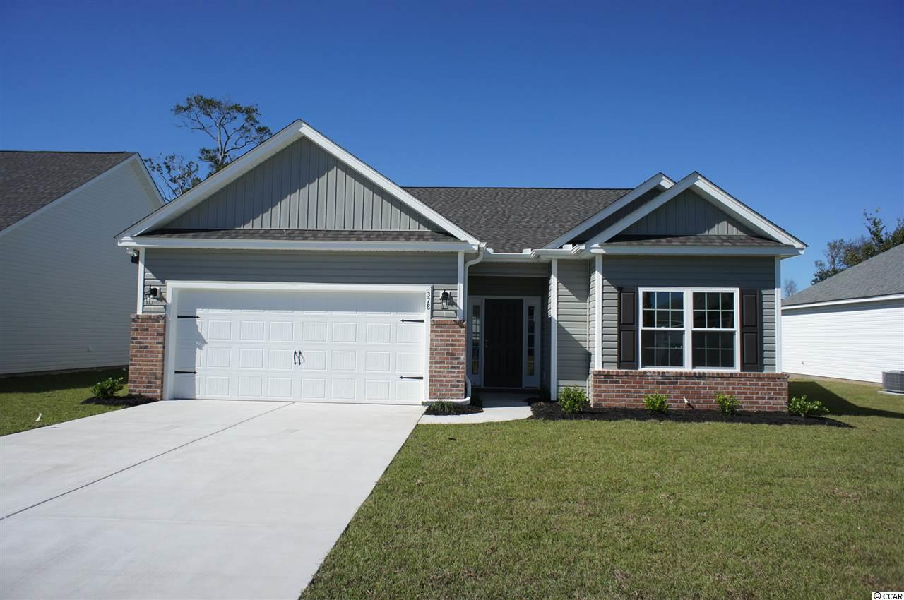 Beautiful Hatteras floor plan in the new Ocean Palms community. This terrific open floor plan, 3 bedroom, 2 full bath home has wood-look water proof vinyl flooring throughout living spaces and carpet in the bedrooms. Stainless appliances, granite counters, staggered-height stained birch cabinetry with a beautiful half moon window in peak of vault and a convenient breakfast bar with pendant combine to give you the wow factor you're looking for, and abundant recessed lighting plus two large windows in the adjacent dining area flood the room with light. There's even a large walk-in pantry with a transom window. A French door in the great room leads to a screened rear porch and separate patio beyond. The spacious master retreat features a long vanity, an oversized walk-in shower, plenty of storage in the linen closet and a huge walk-in closet, plus a tray ceiling. Two additional bedrooms and a full bath are tucked off on their own hallway, for privacy.  All of the homes in Ocean Palms come standard with the luxury of natural gas (tankless water heater, gas heat, and gas range). The two car garage is completely trimmed and painted with an extra bump out perfect for a shop, laundry sink and a floored attic storage space is accessed by drop-down stairs. Ocean Palms is conveniently located near shopping, restaurants, schools and world class medical offices and hospitals, and only a short golf cart ride to Surfside Beach's gorgeous beach and the beautiful Atlantic Ocean. Other floor plans and inventory homes may be available, and CUSTOMIZATION OF FLOOR PLANS IS POSSIBLE!!! Community Pool and Cabana Coming Soon! Photos are of a completed, similar home and may have different features.