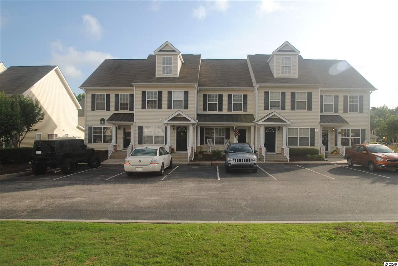 WOW !!  What a great location.  You don't want to miss out on this beautiful 2 Bedroom , 2 full baths and 1 half bath Townhouse close to everything North Myrtle Beach and Little River has to offer! Enjoy being only mins to the Ocean and Main Street North Myrtle Beach. Enter the Townhouse on the first floor which has a spacious open living room and kitchen with stainless steel appliances. Dining area plus an eat in kitchen, half bath and laundry closet.  There is a nice front porch where you can relax with your favorite beverage.  Fence in back porch where you can BBQ. You can relax by the pool or take a dip in the hot tub.  There are 2 master bedrooms upstairs each bedroom has a private full master bath Perfect Beach get away home or primary residence. A short drive to shopping, restaurants, golf courses, beaches and all that the grand strand has to offer.