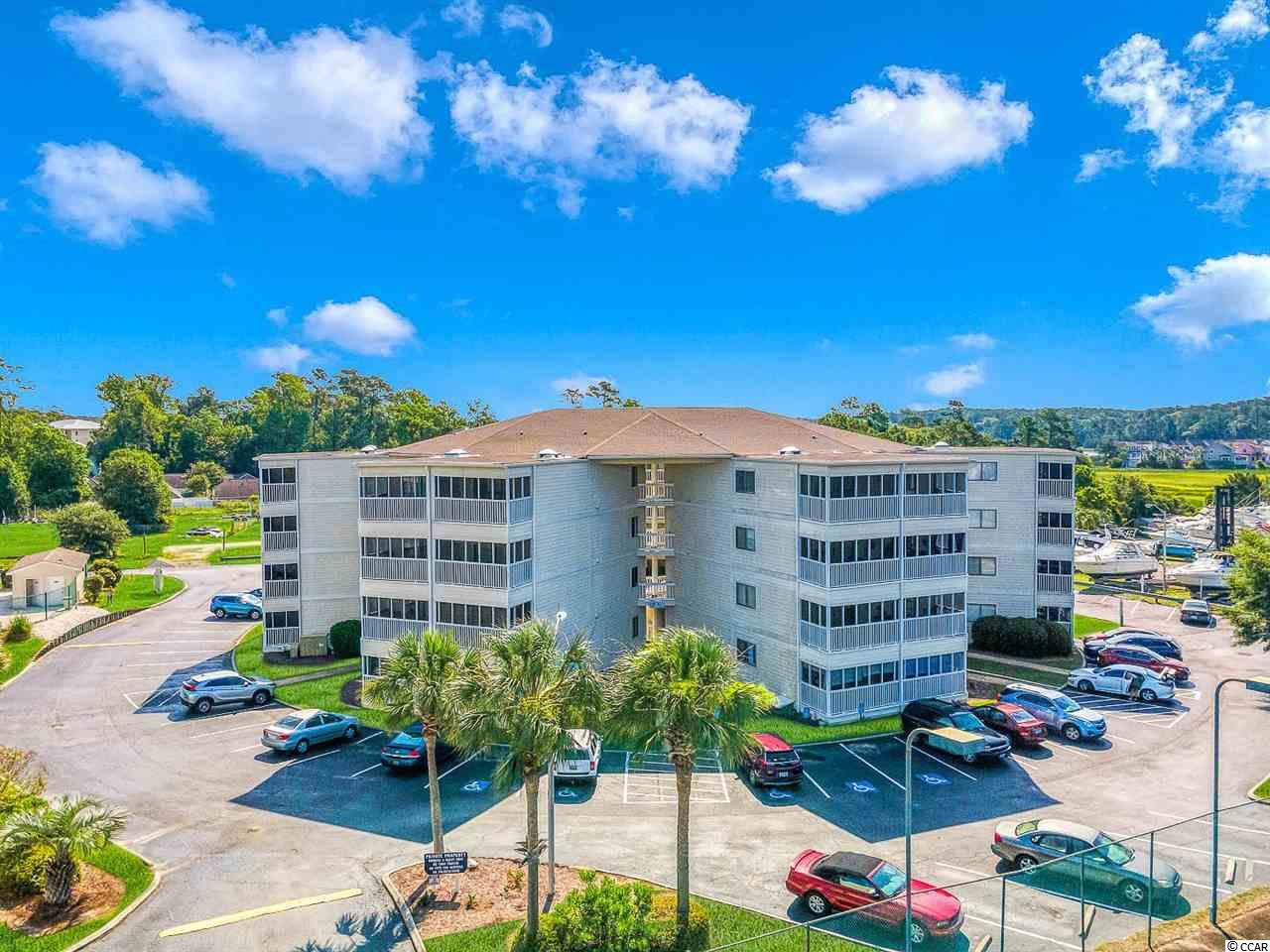 If you're looking for a condo in great shape in the heart of Little River for a steal of a price, you just found it. This updated condo sits in close proximity to the Marina and Waterway. Can't do stairs? No problem! This 4th floor unit has an elevator so no stairs are needed. Perfect for a rental property, second home, or even a primary residence. Very quiet community with a large pool and deck. This unit overlooks the pool and has a great view from the unit and the screened in porch. This property is priced to sell and won't last long, so schedule a showing today!