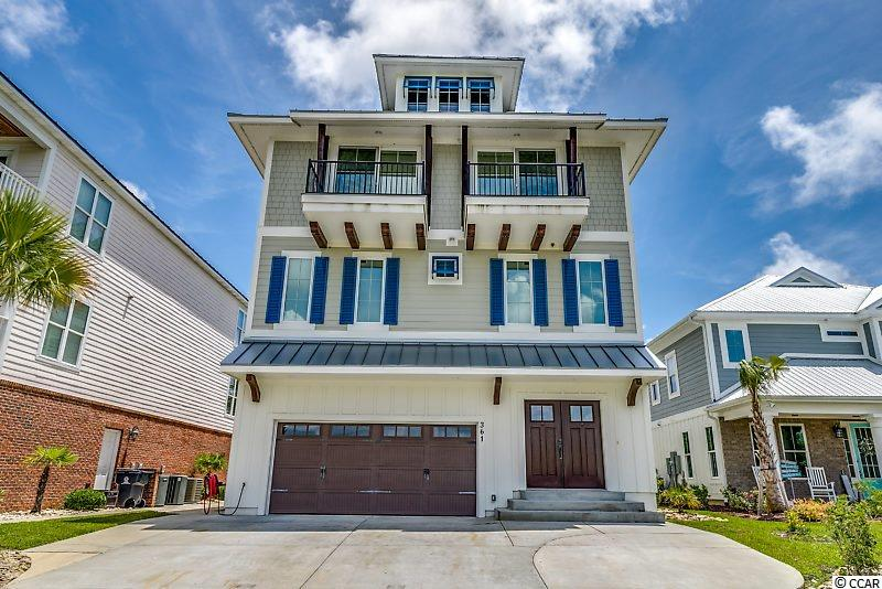 This 4 bedroom custom home overlooks the Intracoastal waterway and offers over 5,000 sqft, a private dock & boat slip with a 10,000 lb lift. Enjoy water views from your numerous porches, master bedroom, living and kitchen areas. The open floor plan offers the perfect setting for entertaining. Beautiful floors and wood work throughout the home. The kitchen offers a gas range, walk in pantry, 2 wine refrigerators, oven, microwave, refrigerator, granite countertops,.....On the 1st level there is a full bar area located off of the porch. The master suite overlooks the water & offers a private porch, walk in closet, master bath w/large tub, separate 2 person shower with body sprays, vanity & double sinks. Beautiful tile work throughout the bath areas & kitchen. Along with the additional bedrooms and baths are 2 laundry areas, a third floor bonus room & walk in attic space. Other amenities include: a tankless gas water heater, a natural gas generator that automatically kicks on when power is lost, inground irrigation, landscape lighting,....  This home is located in Boardwalk on the Waterway, a gated community, that includes a boardwalk running the full length of the community on the Intracoastal Waterway, private boat launch, day dock, and gated outdoor boat storage. The location affords you easy access to the beach and golfing along with all of the other activities and happenings in Myrtle Beach including fun eateries, award winning shows, public fishing piers, and shopping adventures along the Grand Strand. Conveniently located to your everyday needs, including grocery stores, banks, post offices, medical centers, doctors' offices, and pharmacies. Check it out today! Square footage is approximate and not guaranteed. Buyers responsible for verification.