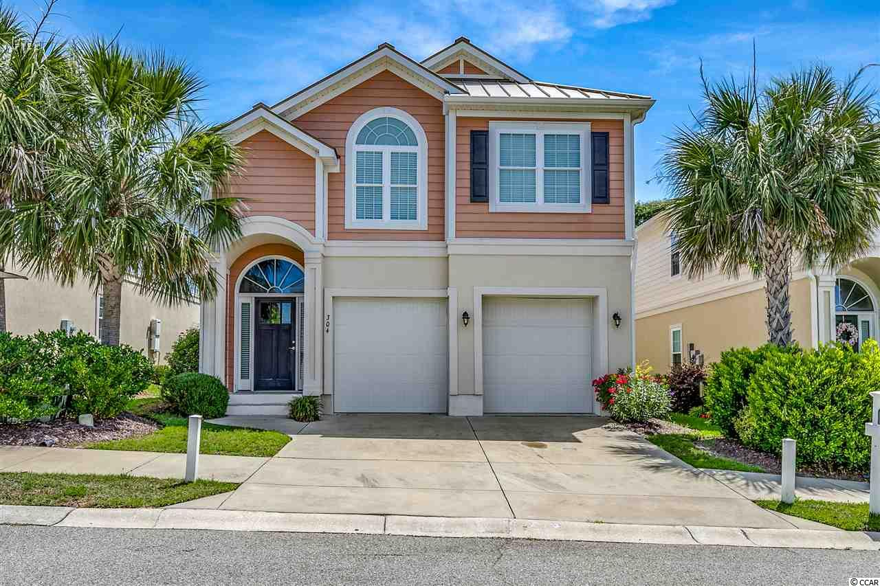 This is a wonderful opportunity to purchase a primary residence or second home with an elevator in the very desirable Ocean Hill neighborhood.  In the Ocean Drive section of North Myrtle Beach, this house is only a block from the beach.  There is a city cabana on  the 6th Ave public access with a plaza, restrooms, shower, and water fountain.  This house was professionally decorated, and is being sold furnished with a few exceptions. Ground floor has a two car garage, a large bedroom, bath with tub and vanity, and a huge rec room with a pool table.  Rec room opens onto a covered patio and a partially fenced backyard.  Upstairs, the large master bedroom has a tray ceiling, and a walk in closet, as well as a walk in shower in the bath, and a vanity with double sinks.  The bedroom opens onto a screened porch which offers a small ocean view from the swing. Ocean Hill is one of the few natural gas communities in North Myrtle Beach, and this house has a tankless gas hot water heater, Whirlpool gas stove, and gas furnace. An outside shower makes it quick and easy to keep sand and salt out of the house when you come back from the beach or the neighborhood pool.  This is beach living at its best!