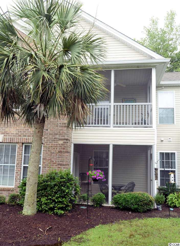 """Spacious, Bright and Airy!  This condo is located in sought after Wachesaw Plantation East; a gated, golf course community in Murrells Inlet, South Carolina's """"Seafood Capitol"""". Offered fully furnished, it is turn-key and ready for you to enjoy right away! Owner has lovingly maintained the home and upgraded furnishings, kitchen appliances, flooring and paint. Even the entry hallway of this building is freshly updated with new flooring, paint and lovely lighting. Formerly the 'model' home for this section of Wyngate @ Wachesaw East, this condo features: upgraded solid wood cabinets w/ pull outs, ceramic floor in kitchen & new Stainless Steel refrigerator, range, range hood and microwave! Bonus=a spacious pantry. ALL Appliances convey. Owner has installed new, high quality laminate plank flooring throughout living spaces incl. bedrooms, (1 yr ago)  updated furnishings include: new double recliner Lazy-boy couch, recliner chair,  new mattress sets in both bedrooms, & clean, coastal decor throughout.  Spacious master bedroom w/ ensuite bath and walk-in closet plus another full bath off the hall for guests and 2nd bedroom. Laundry Room is off hallway with space saving stackables allowing extra utility storage space.  Relax on your screened porch with ceramic tile flooring and ceiling fan. It's the perfect spot to unwind, enjoy morning coffee and bird watch.  Out back, find a shady patio for grilling, chilling & dining al fresco! The community offers so much for such an affordable HOA fee! 24-7 guarded gate, large Swimming pool, tennis & pickleball courts, basketball, workout room, affordable golf memberships, +walking & fitness trails throughout the neighborhood. Wachesaw E. residents enjoy a choice of two top cable & Internet providers featuring newly laid fiber optic underground. Less than 2mi to the Famous Murrell's Inlet Marshwalk; a boardwalk of waterfront restaurants and nightlife options, 5 miles to Huntington Beach State Park's pristine, natural beach + picturesq"""