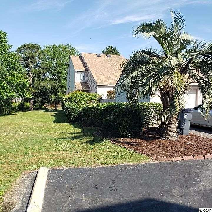 BEAUTIFUL , RARE, WELL MAINTAINED, ABSOLUTE END UNIT TOWN HOME IN THE HIGHLY DESIRABLE FAIRWAY LAKES NEIGHBORHOOD! THIS 3 BEDROOM/3BATH UNIT HAS THE MOST AMAZING VIEWS OF MYRTLEWOOD GOLF COURSE AND THE INTERCOASTAL WATERWAY! ENJOY YOUR MORNING COFFEE IN YOUR PRIVATE COURTYARD, OR TOAST TO AN AMAZING SUNSET FROM YOUR BACK PORCH. COZY UP IN THE WINTERTIME TO YOUR WOOD BURNING FIREPLACE! THIS HOME HAS ALL THE BELLS AND WHISTLES, AND SHOULD BE AT THE TOP OF YOUR WISH LIST!!