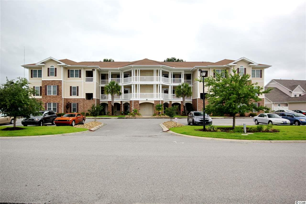 Beautiful 1st floor unit with amazing views of the 15th hole of the International Club golf course. Well designed open floor plan with 1993 sq ft with spacious 3 bedrooms and 2.5 bathrooms all on one level first floor. Very well cared for one owner unit. New HVAC system and hot water heater installed in August of 2018. Spacious kitchen over looking the dining room and living room. Featuring 4 ft white satin Northern Contours cabinets, tile back splash, brush nickel faucet with pull down sprayer and Corian countertops. Spacious living room with Shaw Castle Ridge laminate flooring, electric fireplace, 9 foot ceilings and crown moldings. Kitchen, foyer, entrance hallway and bathrooms are all tile floors. Master bedroom is very spacious with access to the screened in patio out back and walk-in closet. Master bathroom has double sinks, custom cultured marble shower and corner tub. Spacious laundry room with walk-in pantry. Back covered porch has beautiful Porcelain flooring and views of 15th hole. This unit is truly in a wonderful golf course community. The HOA's include cable, trash, exterior building maintenance, landscaping, and more. This well cared for condo unit is a must see to appreciate.