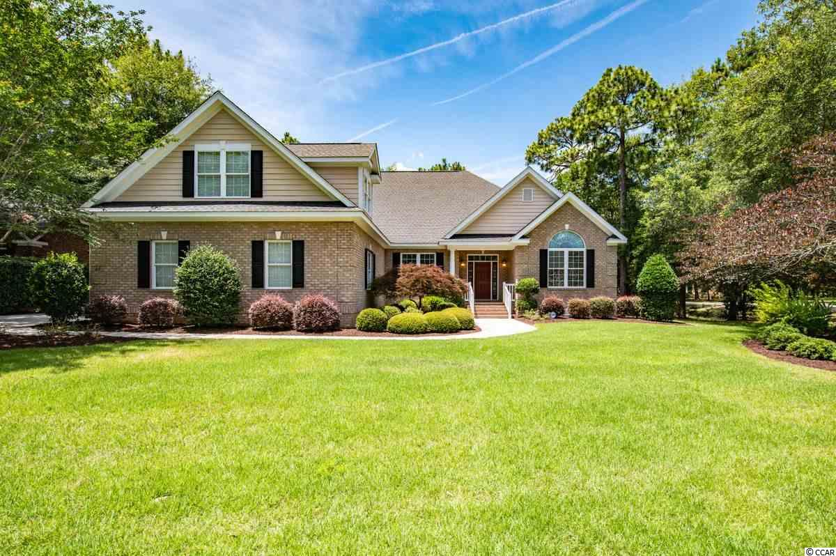 Situated on a corner lot with gorgeous pond views, you'll find this gem of a home in The Reserve. This all brick home has 4 bedrooms and 3.5 bathrooms. Above the garage is a spacious room and full bath that could be used as a 5th bedroom, entertainment space, or bonus room. Upon entering the home, you will be in awe at the vaulted ceilings, 9 ft doorways, beautiful hardwoods floors, and crown molding throughout. This home has an open floor plan with formal dining area, living room, fireplace and spacious kitchen with breakfast nook. The master bedroom boasts views of the pond and contains a large ensuite bathroom with a whirlpool tub, shower, double vanity and walk in closet. Other features of the house include: Workshop area, large screened porch,  sitting area in back yard, deck and nicely manicured landscaping. The Reserve is a gated neighborhood and one of Pawleys Island's most distinguished communities with walking paths, swimming pool, a marina, golf course and Litchfield by the Sea access. The golf club and Marina are private, requiring additional memberships. You are a short golf cart ride away from your private beach access through Litchfield By The Sea. Come take a look at this amazing home located in Pawleys Island, SC.