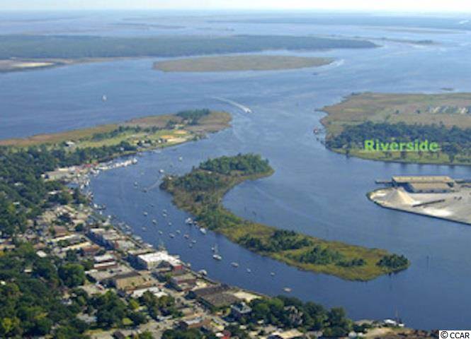 Own your slice of paradise on the Sampit River! Sportsman's playground off Park St. Georgetown, SC. Perfect for Subdivision or Private Retreat, Possibilities are endless. Access to 5 freshwater rivers & Atlantic Ocean, 10 golf courses & sandy beaches within 30-minutes. Zoned R-4 for single family/multi-family units. Water, sewer & all utilities available. Tract lies in a tax credit Opportunity Zone.