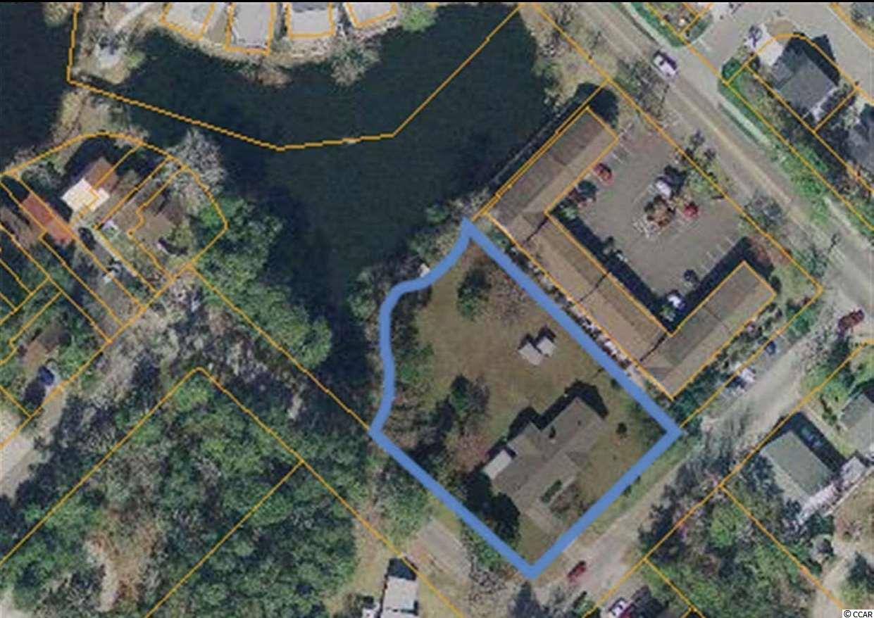 Double corner lot within walking distance to the beach.  This large lot is perfect for an investor or building and can be a new townhome community with room for up to 12 townhomes.  There is an existing brick home on the property that coveys with the sale.  No HOA for this property, not in a flood zone and low insurance costs.